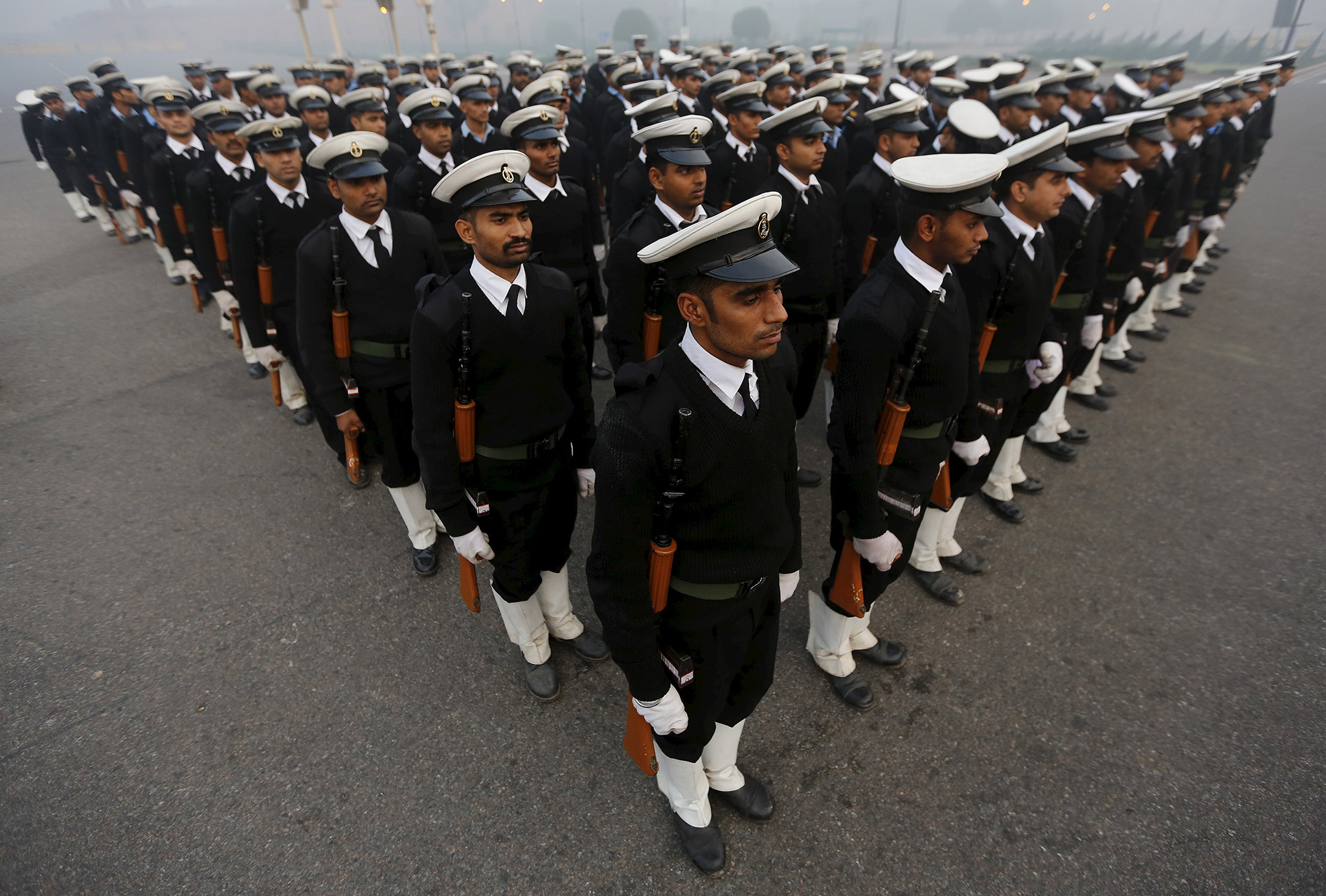 Indian soldiers take part in the rehearsal for the Republic Day parade on a foggy winter morning in New Delhi, India
