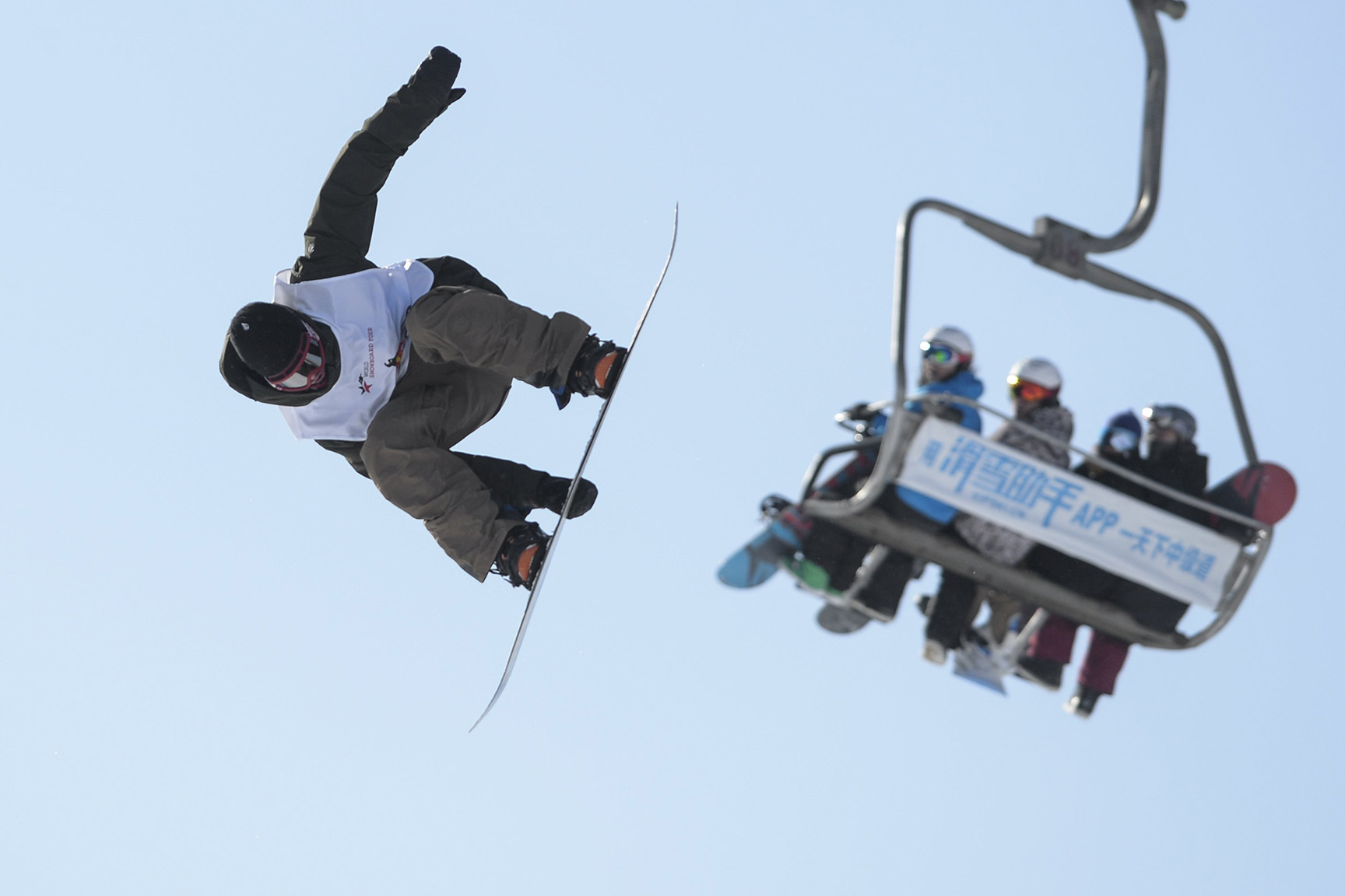 A snowboarding contestant takes a jump during a competition in Beijing