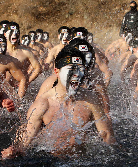 Soldiers conduct 'severe-cold period' drill...epaselect epa05115211 A group of soldiers affiliated with an Army unit under the Special Warfare Command sing a martial song in unison after entering a reservoir by breaking the ice on its surface in Hongcheon, Gangwon Province, South Korea, 21 January 2016. The day is known as 'daehan,' one of the 24 seasonal divisions of the lunar calendar that marks the arrival of the coldest day of the year. The exercise in cold water is part of the unit's tactical drill tailored for the winter's severe cold period.  EPA/STRINGER SOUTH KOREA OUT