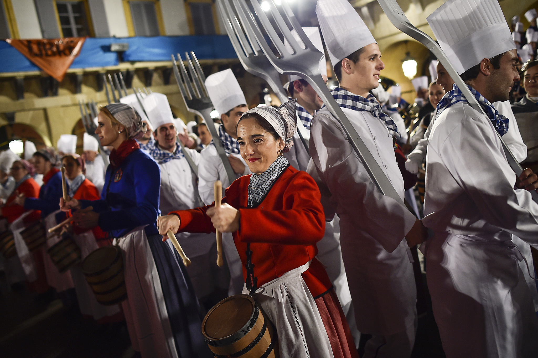 """Tamborilleros'' wearing their uniforms take part in the opening ceremony of the main day of the traditional ""La Tamborrada"" of San Sebastian feasts in the Basque city of San Sebastian, northern Spain, Wednesday, Jan. 20, 2016. From midnight to midnight companies of perfectly uniformed marchers parade through the streets of San Sebastian playing drums and barrels in honor of their patron saint. (AP Photo/Alvaro Barrientos)"