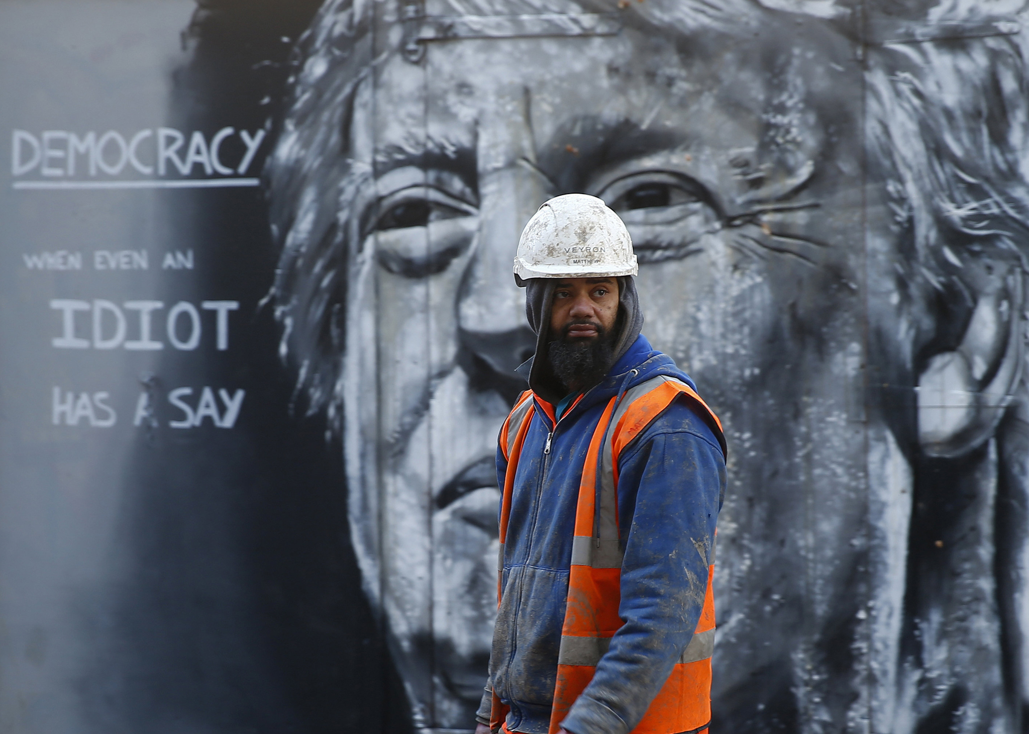 A construction worker stands in front of a piece of street art portraying prospective U.S. Presidential candidate Donald Trump, in east London...A construction worker stands in front of a piece of street art portraying prospective U.S. Presidential candidate Donald Trump, in east London, January 28, 2016. An online petition to bar Trump from entering the United Kingdom recently triggered a debate in Parliament after if was signed by over 500,000 people. REUTERS/Andrew Winning EDITORIAL USE ONLY. NO RESALES. NO ARCHIVE