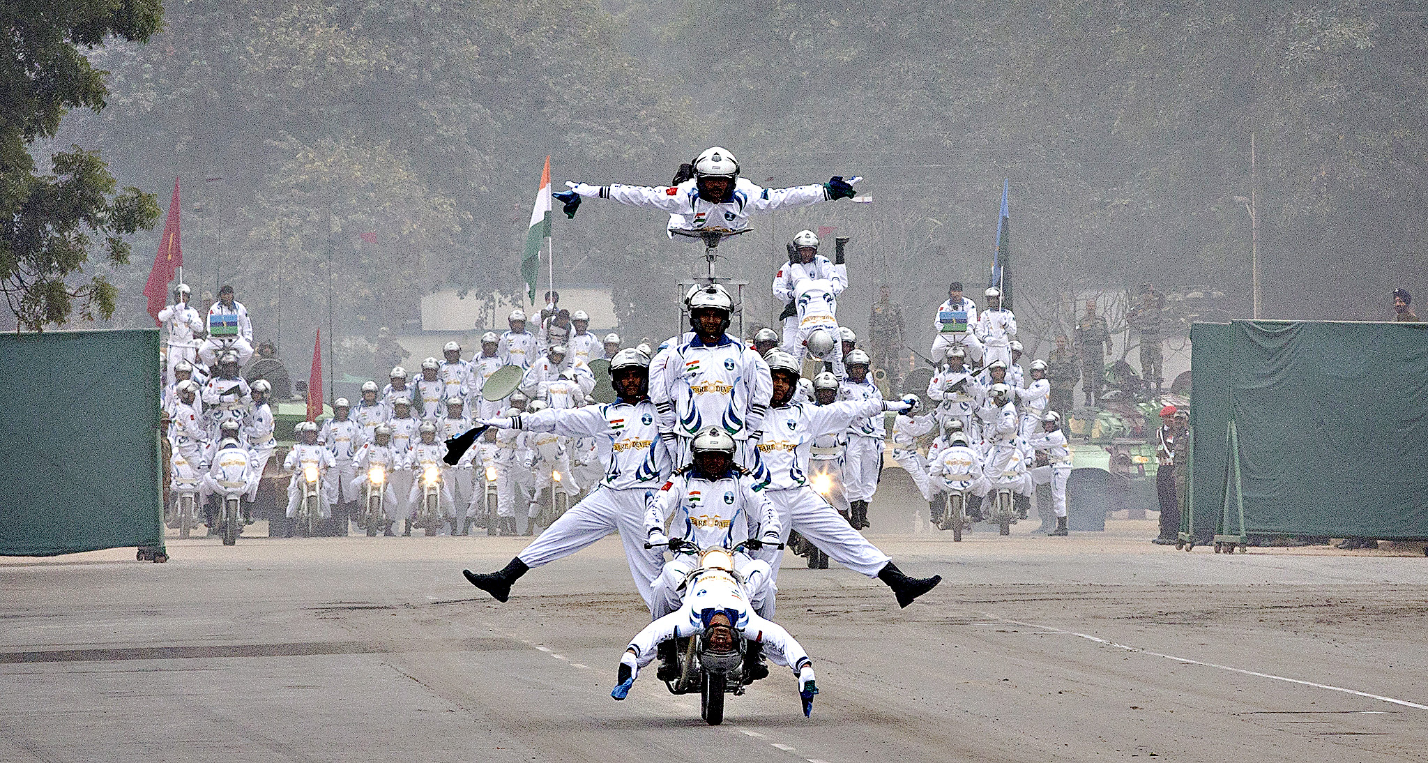 Indian army dare devils display their skills on motorcycles during the Army day parade in New Delhi, India, Friday, Jan. 15, 2016. The Indian army is the third largest army in the world.