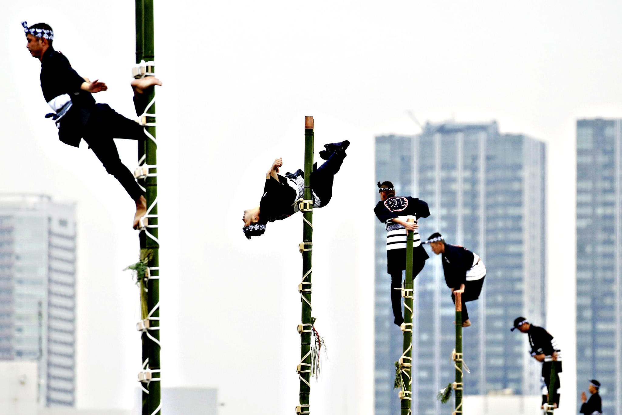 New Year's Fire Review in Japan...epa05089354 Members of the Edo Firemanship Preservation Association balance on top of bamboo ladders during a demonstration at the New Year's fire review held by the Tokyo Fire Department in Tokyo, Japan, 06 January 2016. Some 2,800 firefighters perform various emergency rescue and firefighting demonstrations in an effort to promote the prevention of fire and disaster in the annual event.