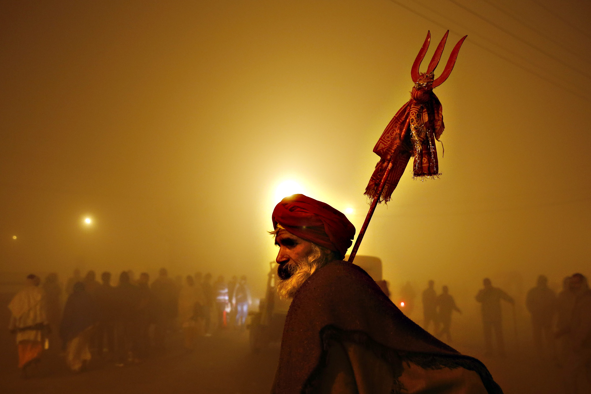 An Indian Hindu devotee arrives early morning at the banks of Sangam, the confluence of the Ganges, Yamuna and mythical Saraswati River, during the Makar Sankranti festival in Allahabad, India, Friday, Jan. 15, 2016. Makar Sankranti marks the beginning of the sun's northward movement according to the solar calendar and considered to be auspicious.