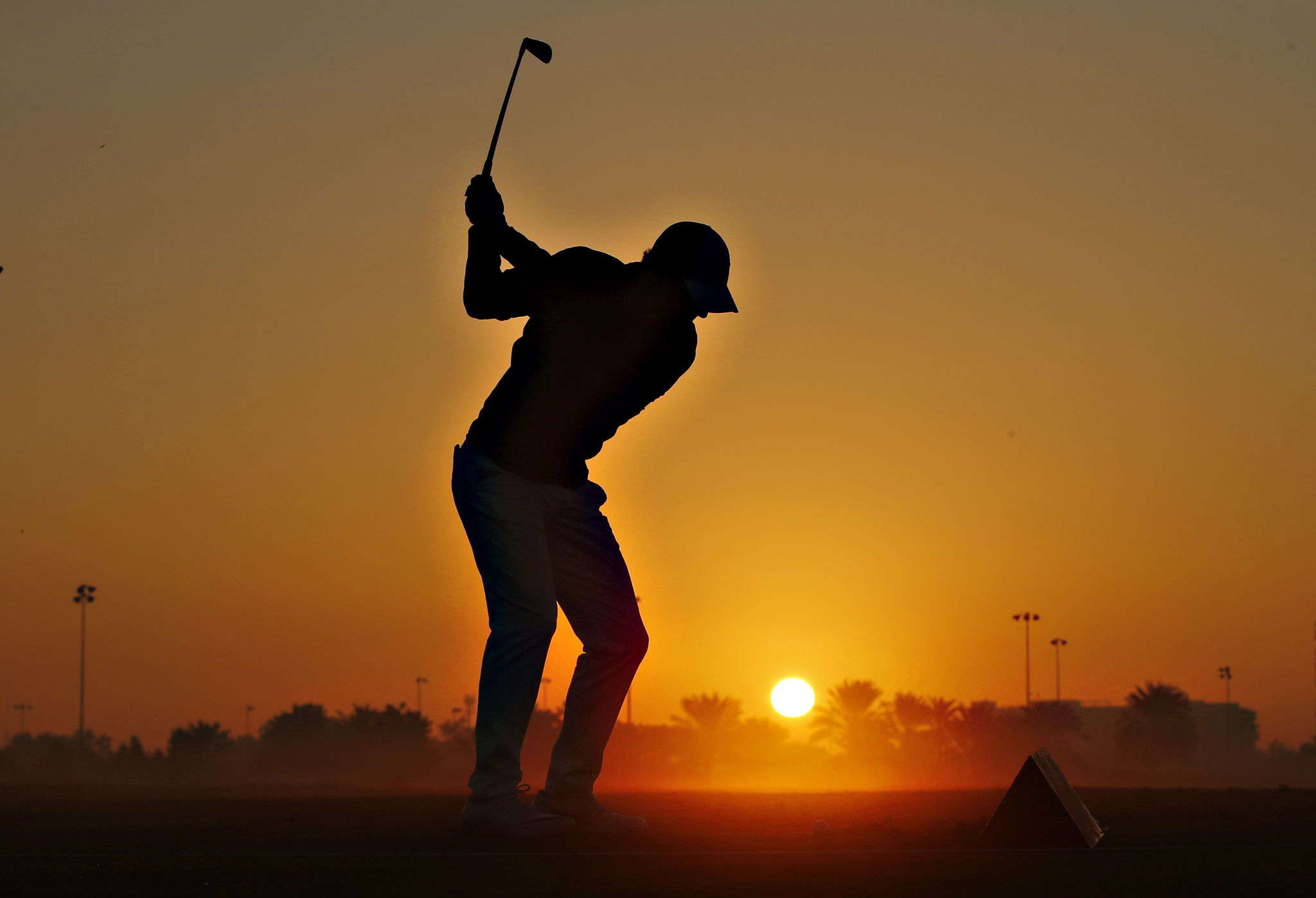 Golf - Abu Dhabi HSBC Golf Championship - Abu Dhabi Golf Club, United Arab Emirates - 21/1/16  Northern Ireland's Rory McIlroy practices on the driving range before the start of the first round