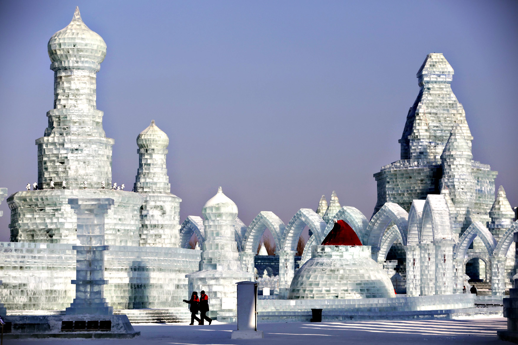 People look around ice sculptures ahead of the Harbin International Ice and Snow Festival in the northern city of Harbin, Heilongjiang province, January 4, 2016.