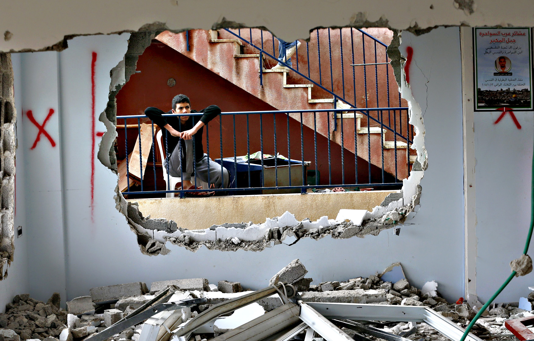 A relative looks at the demolished house of Palestinian Bahaa Mohammed Halil Allyan in the Arab east Jerusalem neighbourhood of Jabel Mukaber on Monday