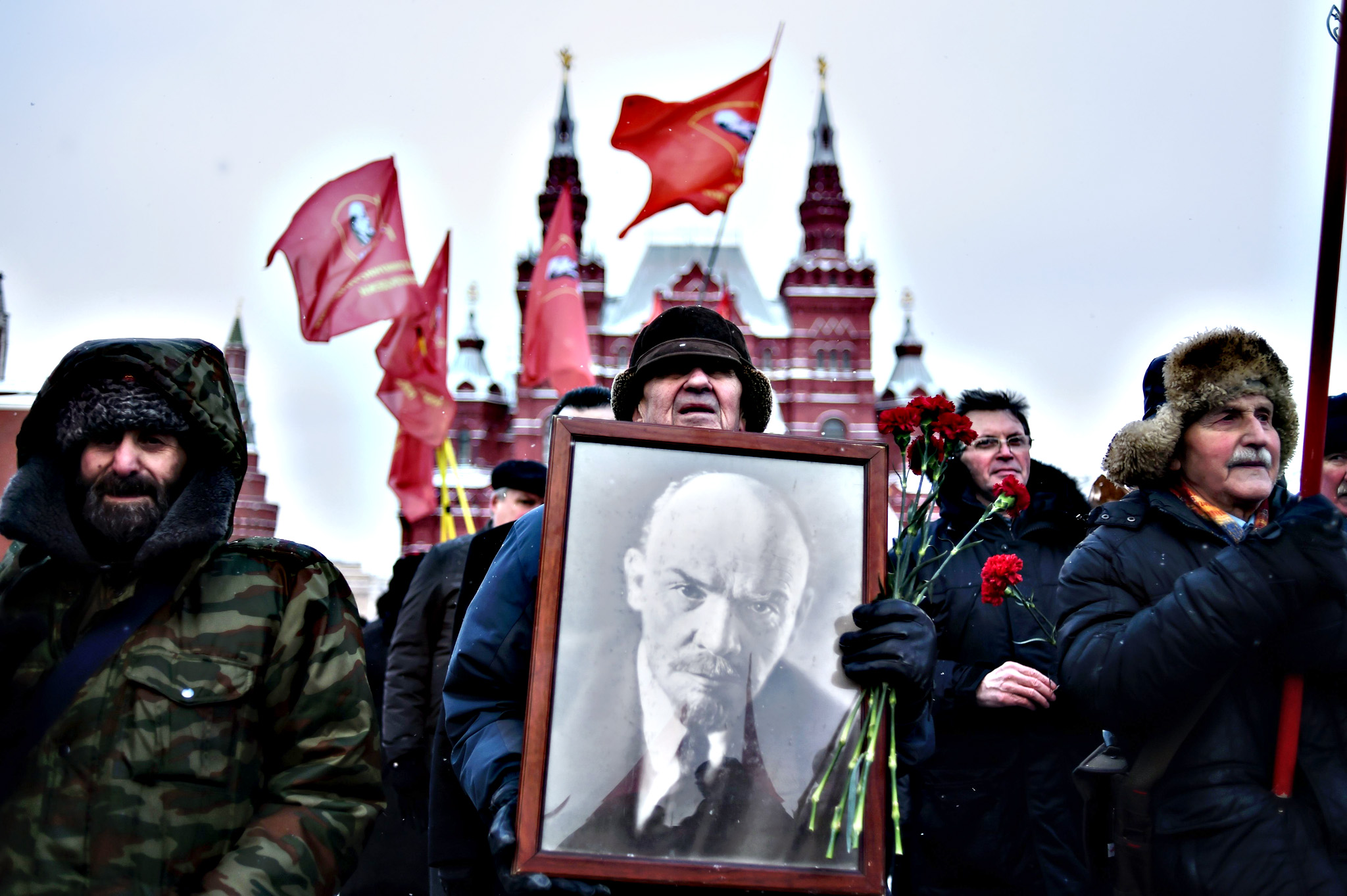 Russian Communist Party supporters carry a portrait of late Soviet leader Vladimir Lenin as they take part in a memorial ceremony to mark the 92st anniversary of his death at Red Square in central Moscow on January 21, 2016.