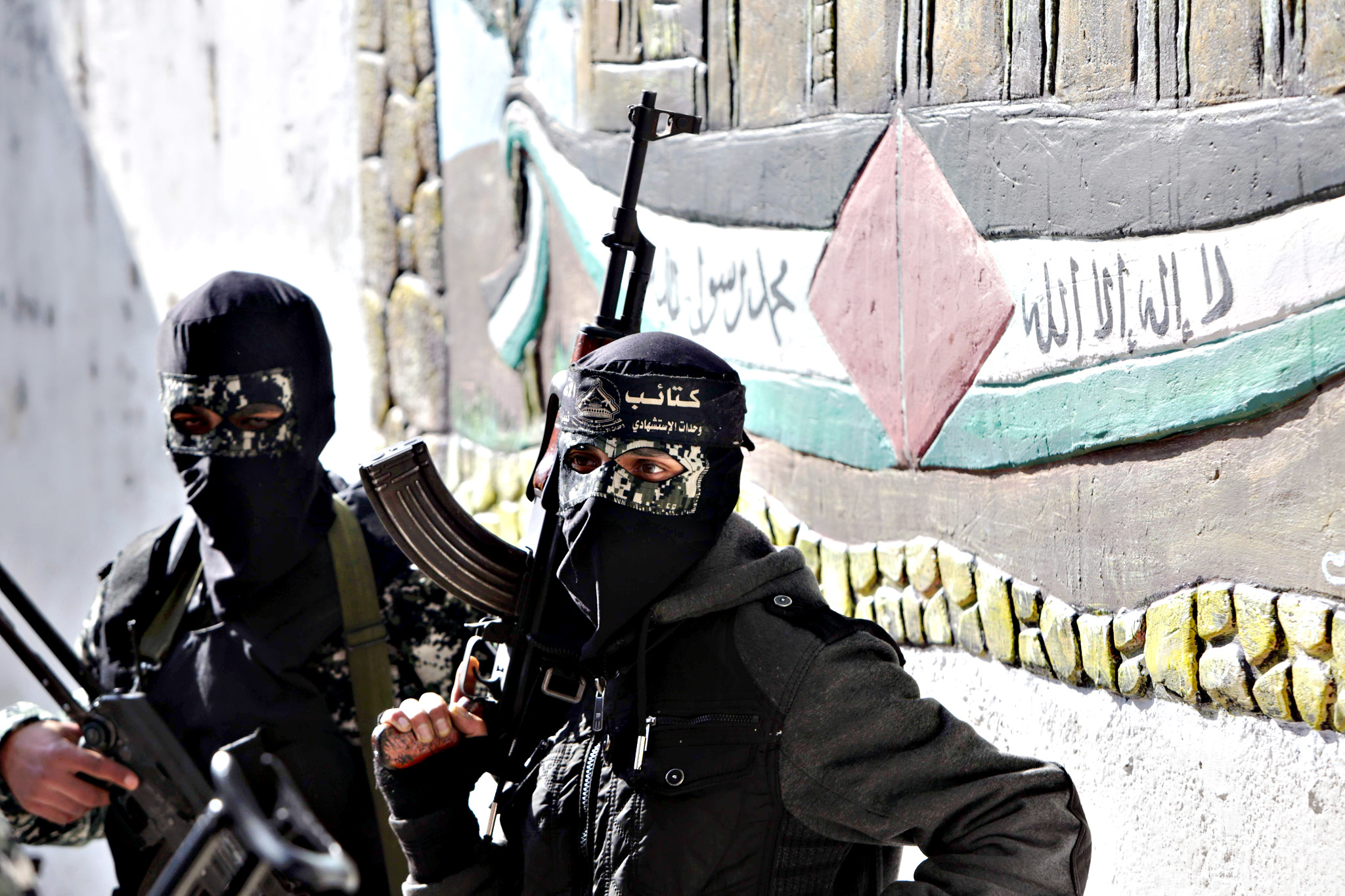 Masked Palestinian militants from the al-Aqsa Martyrs Brigades, a group linked to the Fatah movement, attend the funeral of Mussa Abu Zuaiter, a Palestinian man who was killed in an Israeli air strike on the Gaza Strip, in the Jabalia refugee camp in the northern Gaza Strip on Wednesday.  An Israeli air raid in the northern Gaza Strip targeting alleged militants killed one Palestinian and wounded three others, the Israeli army and a Palestinian official said.