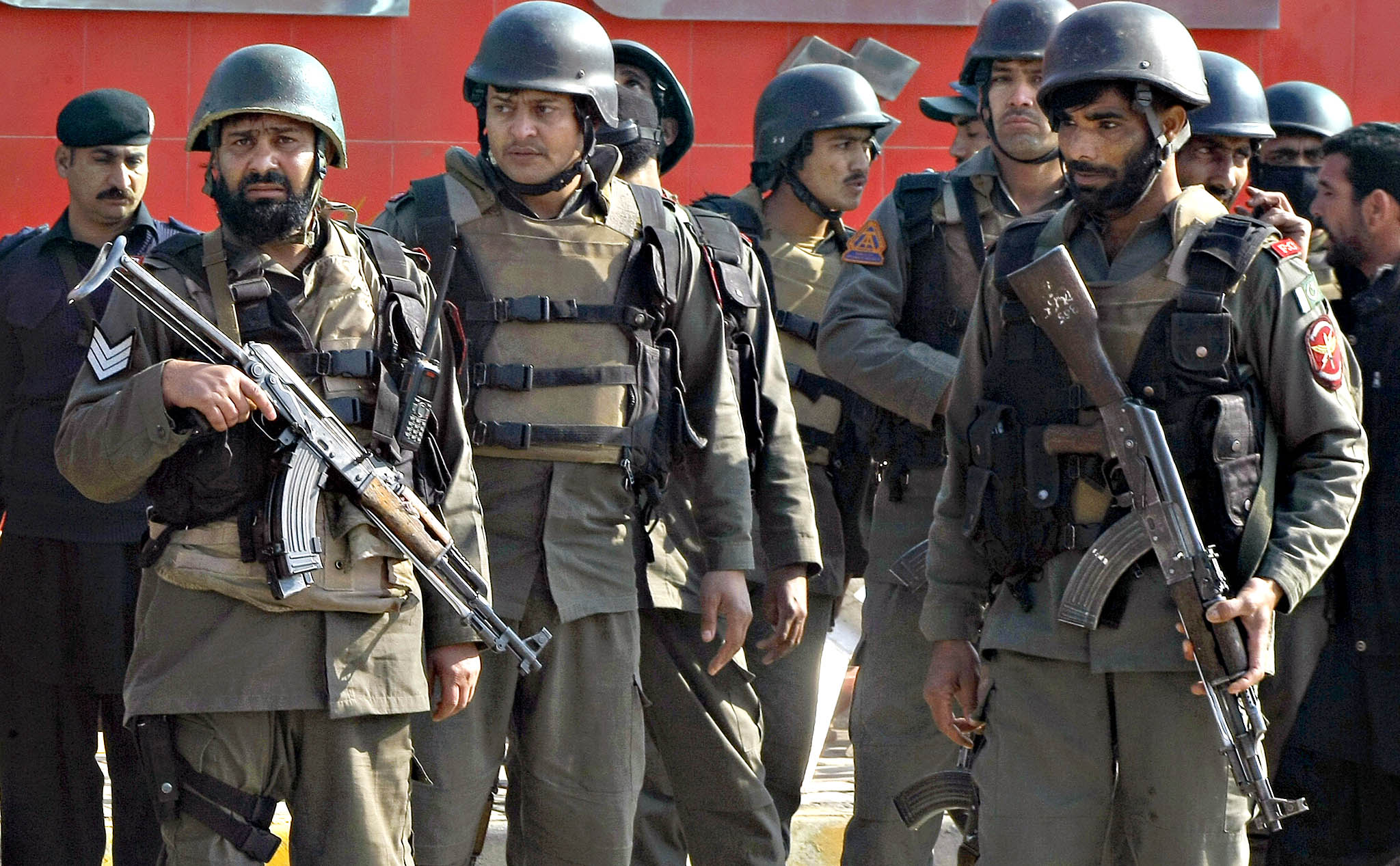 Pakistani troops arrive at Bacha Khan University in Charsadda town, some 35 kilometers (21 miles) outside the city of Peshawar, Pakistan, Wednesday, Jan. 20, 2016. Gunmen stormed Bacha Khan University named after the founder of an anti-Taliban political party in the country's northwest Wednesday