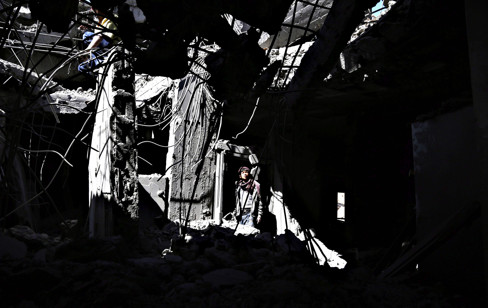 A Yemeni inspects his family's apartment destroyed by airstrikes allegedly carried out by the Saudi-led coalition targeting a neighborhood in Sanaa, Yemen, 04 January 2016. The nine-month conflict in Yemen has escalated dramatically since the Saudi-led coalition started conducting airstrikes against the Houthi rebels in March, with more than 6000 people killed.