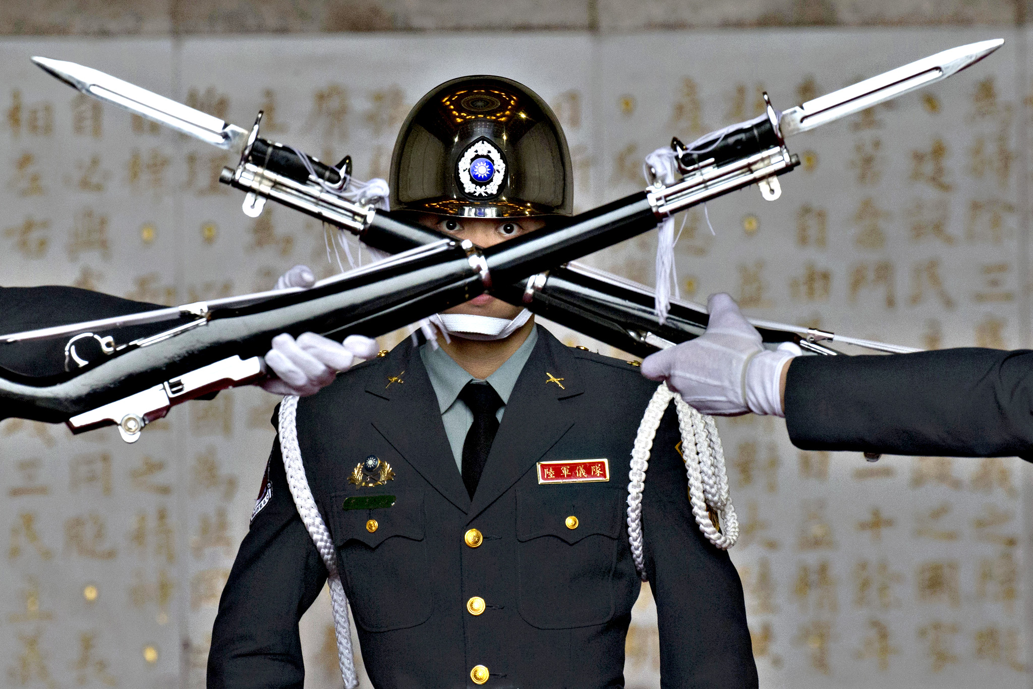 A member of the Taiwanese honor guard takes part in a change of duty ceremony at the Chiang Kai-shek Memorial Hall in Taipei, Taiwan, Friday, Jan. 15, 2016. Taiwan will hold its presidential election on Saturday, Jan. 16.