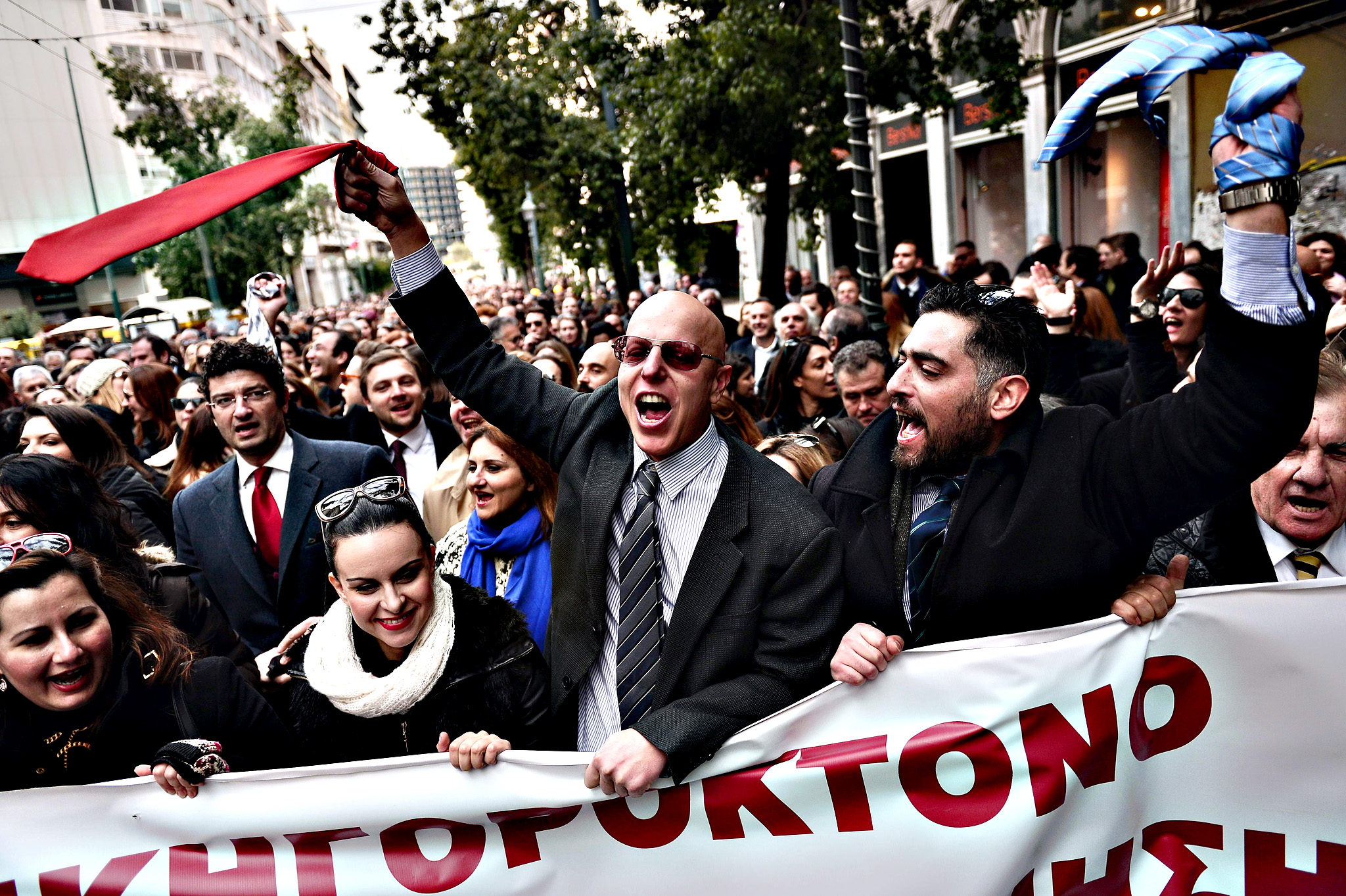 Lawyers wave their ties during a rally in central Athens against the social security reforms proposed by the government, on Thursday.   Thousands of scientists, doctors, lawyers, engineers and self employed professionals participated in the massive rally, in protest againt a government draft bill regarding reforms in the countrys pension system