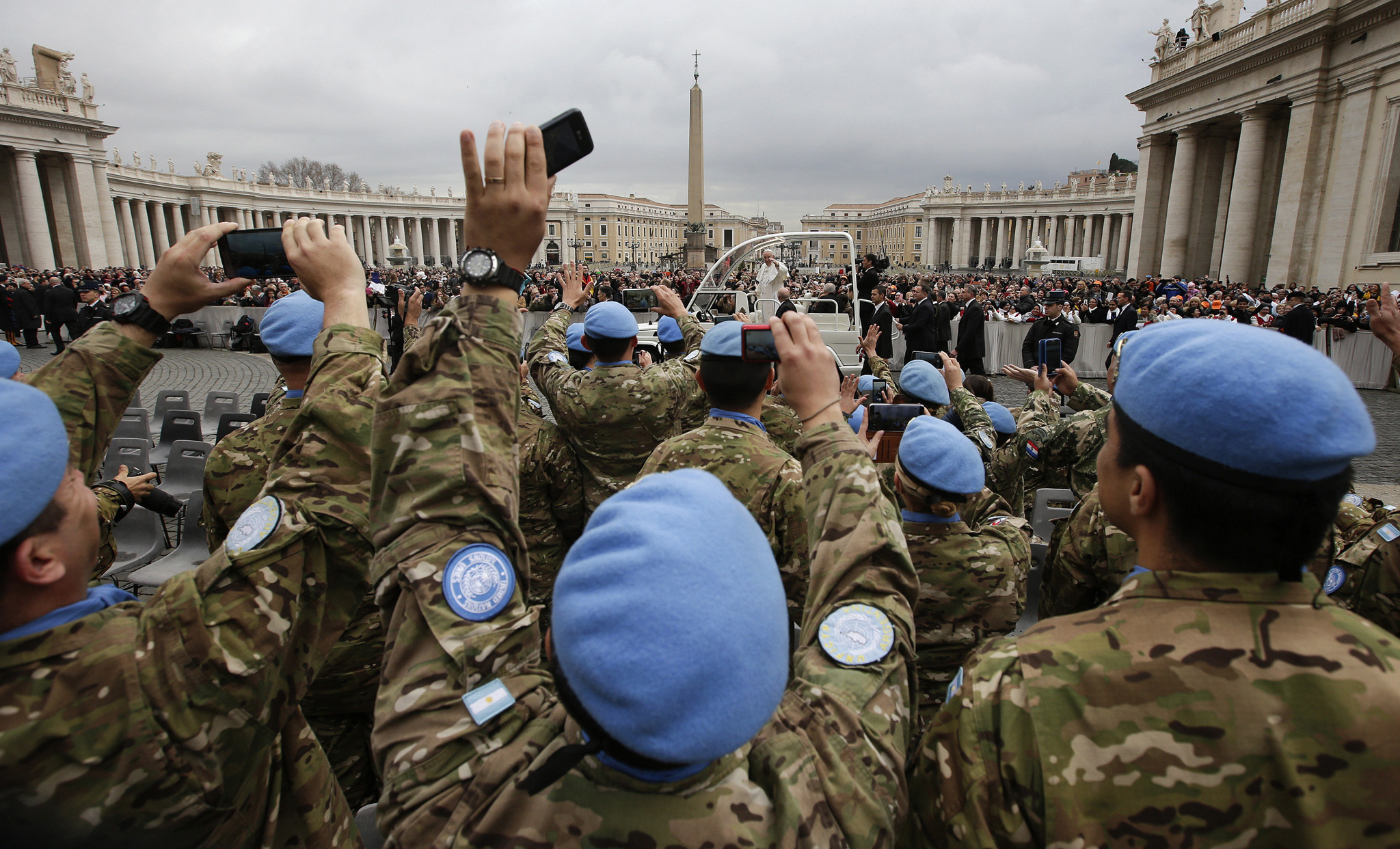 Argentinian United Nations soldiers wave to Pope Francis
