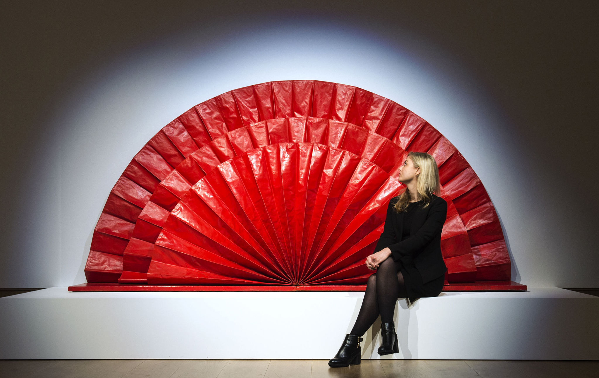 onham's Post-War and Contemporary Art Sale...A woman walks past Untitled (Red Fan) by Kazuo Shiraga, estimated at between £1,500,000 and £2,000,000, during the press preview of Bonham's forthcoming Post-War and Contemporary Art Sale which will be held on February 11 in London. PRESS ASSOCIATION Photo. Picture date: Monday February 1, 2016. Photo credit should read: Anthony Devlin/PA Wire