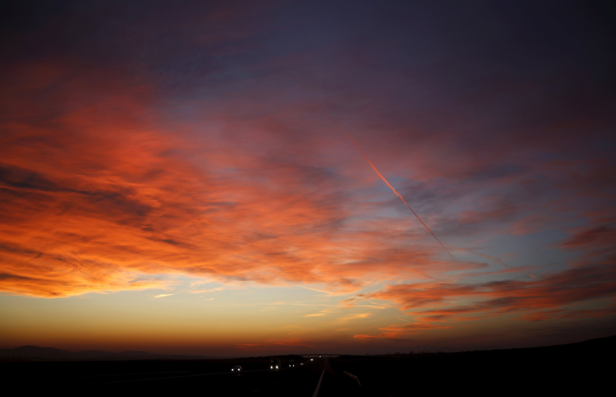 Vehicles are seen on a highway as the sun sets near the city of Stara Zagora...Vehicles are seen on a highway as the sun sets near the city of Stara Zagora, Bulgaria, February 3, 2016. REUTERS/Stoyan Nenov