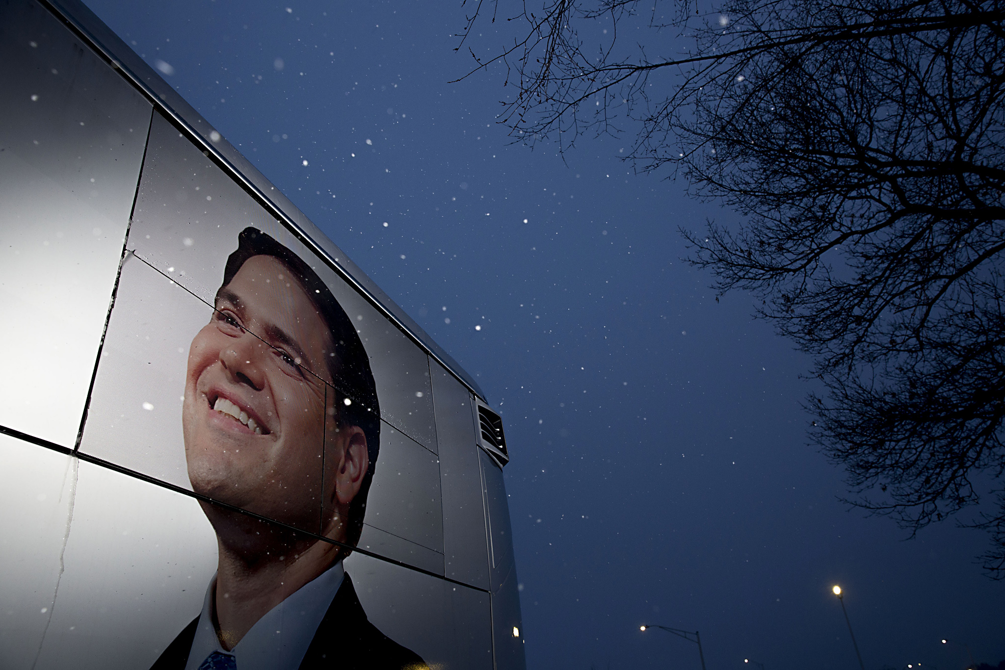 Presidential Candidate Marco Rubio Holds Retail Campaign Stops...An image of Senator Marco Rubio, a Republican from Florida and 2016 presidential candidate, is seen on his campaign bus as it sits outside the building which houses his campaign headquarters in Manchester, New Hampshire, U.S., on Monday, Feb. 8, 2016. Rubio, who surged to second place in polls after coming in third in the Iowa caucuses, spent Sunday trying to extinguish a political brushfire after he delivered the same canned answer three times within a matter of minutes at Saturday's presidential debate. Photographer: Daniel Acker/Bloomberg