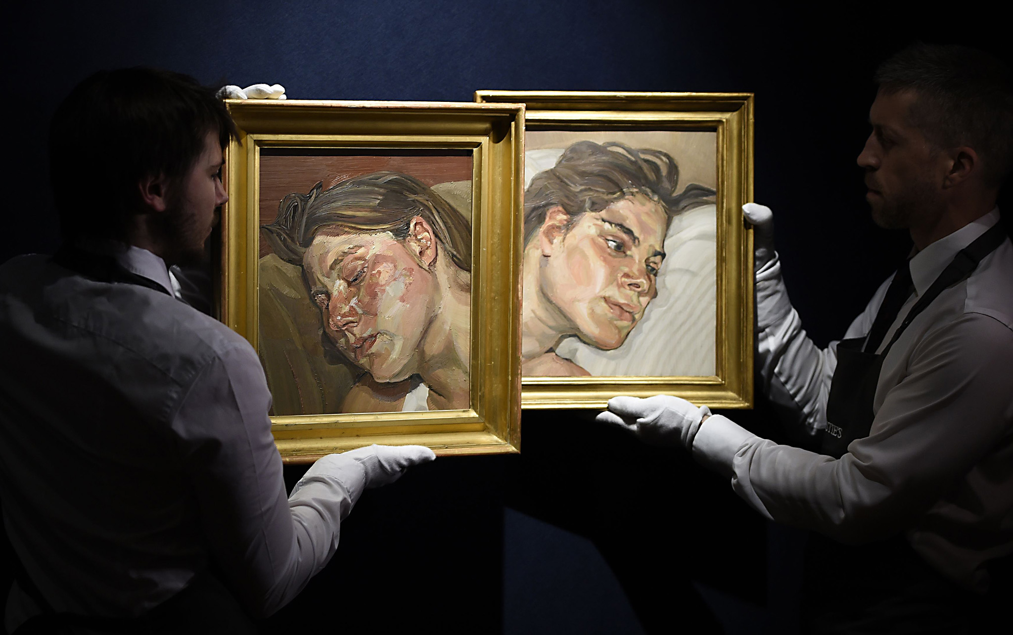 Post War and Contemporary Art sales - London...Christie's gallery assistants adjust Head of IB (left) and Head of Esther by Lucian Freud, during a press preview of their forthcoming Post War and Contemporary Art sales at Christie's in London. PRESS ASSOCIATION Photo. Picture date: Friday February 5, 2016. Photo credit should read: Lauren Hurley/PA Wire