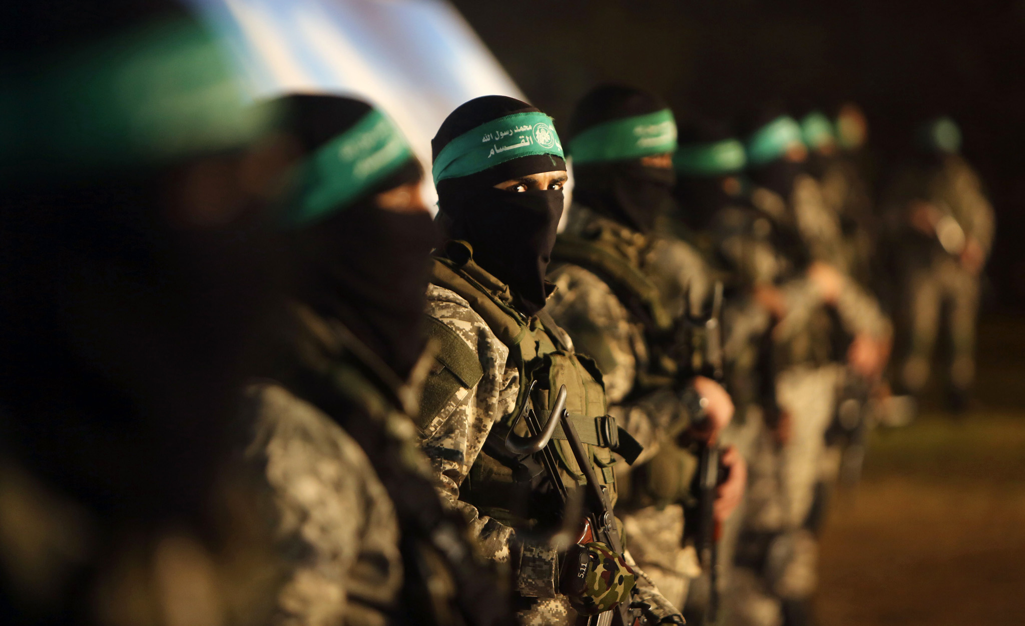 TOPSHOT - Palestinian members of the Ezz...TOPSHOT - Palestinian members of the Ezzedine al-Qassam Brigades, the armed wing of the Hamas movement, take part in a gathering on January 31, 2016 in Gaza city to pay tribute to their fellow militants who died after a tunnel collapsed in the Gaza Strip.  Seven Hamas militants were killed on January 28, 2016 after a tunnel built for fighting Israel collapsed in the Gaza Strip, highlighting concerns that yet another conflict could eventually erupt in the Palestinian enclave.  / AFP / MAHMUD HAMSMAHMUD HAMS/AFP/Getty Images
