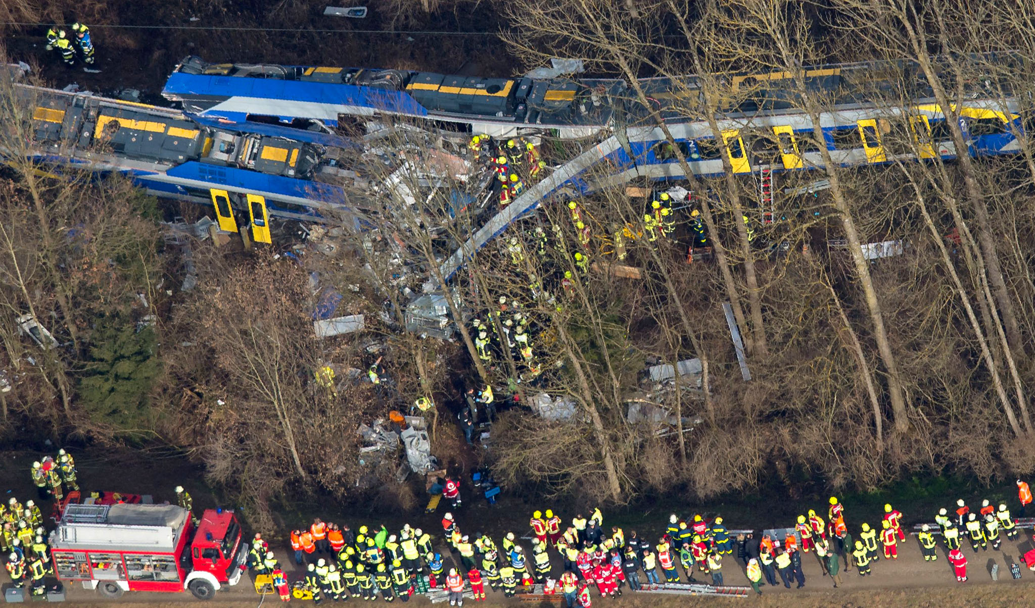 ALTERNATIVE CROP - Firefighters and emer...ALTERNATIVE CROP - Firefighters and emergency doctors work at the site of a train accident near Bad Aibling, southern Germany, on February 9, 2016. Two Meridian commuter trains operated by Transdev collided head-on near Bad Aibling, around 60 kilometres (40 miles) southeast of Munich, killing at least eight people and injuring around 100, police said. The cause of the accident was not immediately clear. / AFP / dpa / Peter Kneffel / Germany OUTPETER KNEFFEL/AFP/Getty Images
