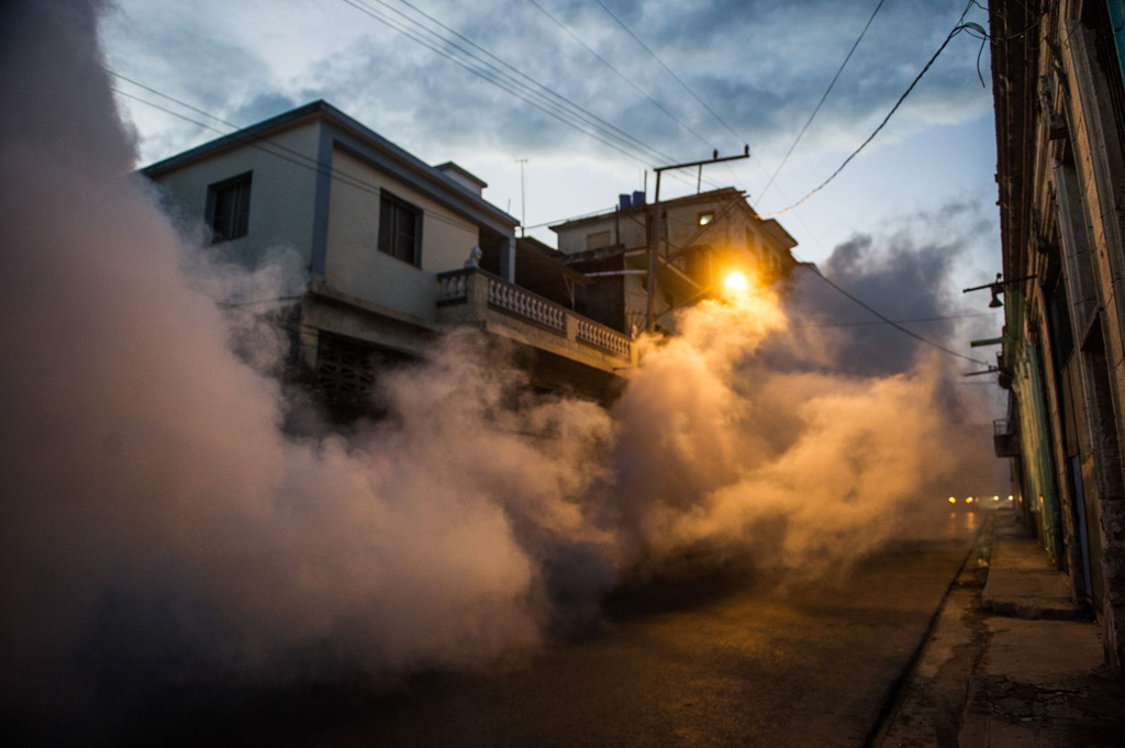 Health authorities with the help of the Cuban army fumigate against the Aedes aegypti mosquito to prevent the spread of zika, chikungunya and dengue in a street of Havana