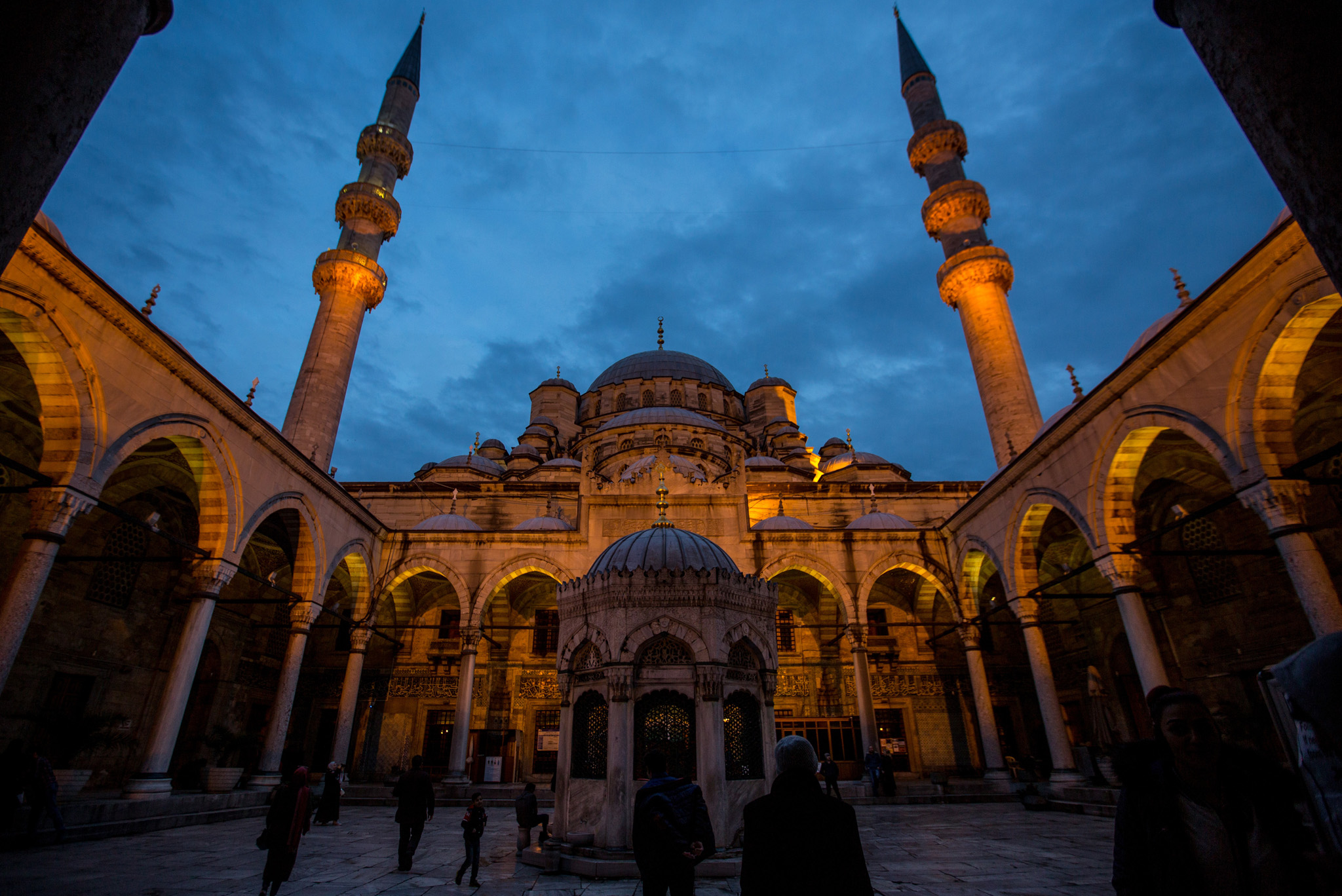 People enter the Eminonu Mosque in Istanbul, Turkey