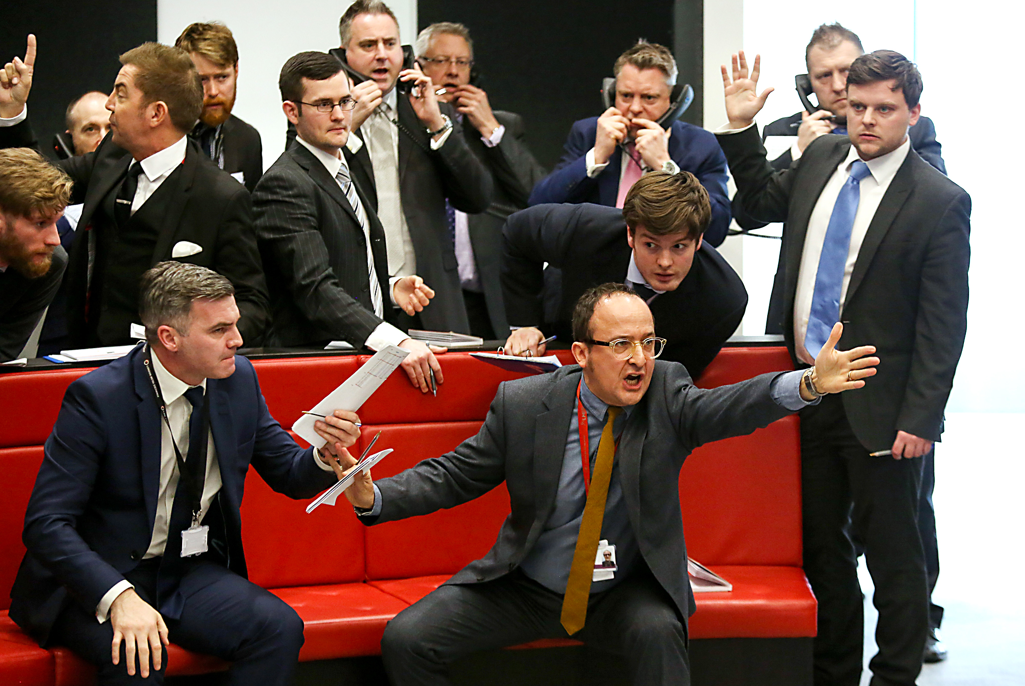 Trading Ring Unveiled Inside London Metals Exchange's New Premises...Traders, brokers and clerks shout and gesture on the trading floor of the open outcry pit at the London Metal Exchange (LME), at their new premises on Finsbury Square, in London, U.K in London, U.K., on Thursday, Feb. 18, 2016. The new LME ring has capacity to host 14 members. Photographer: Chris Ratcliffe/Bloomberg