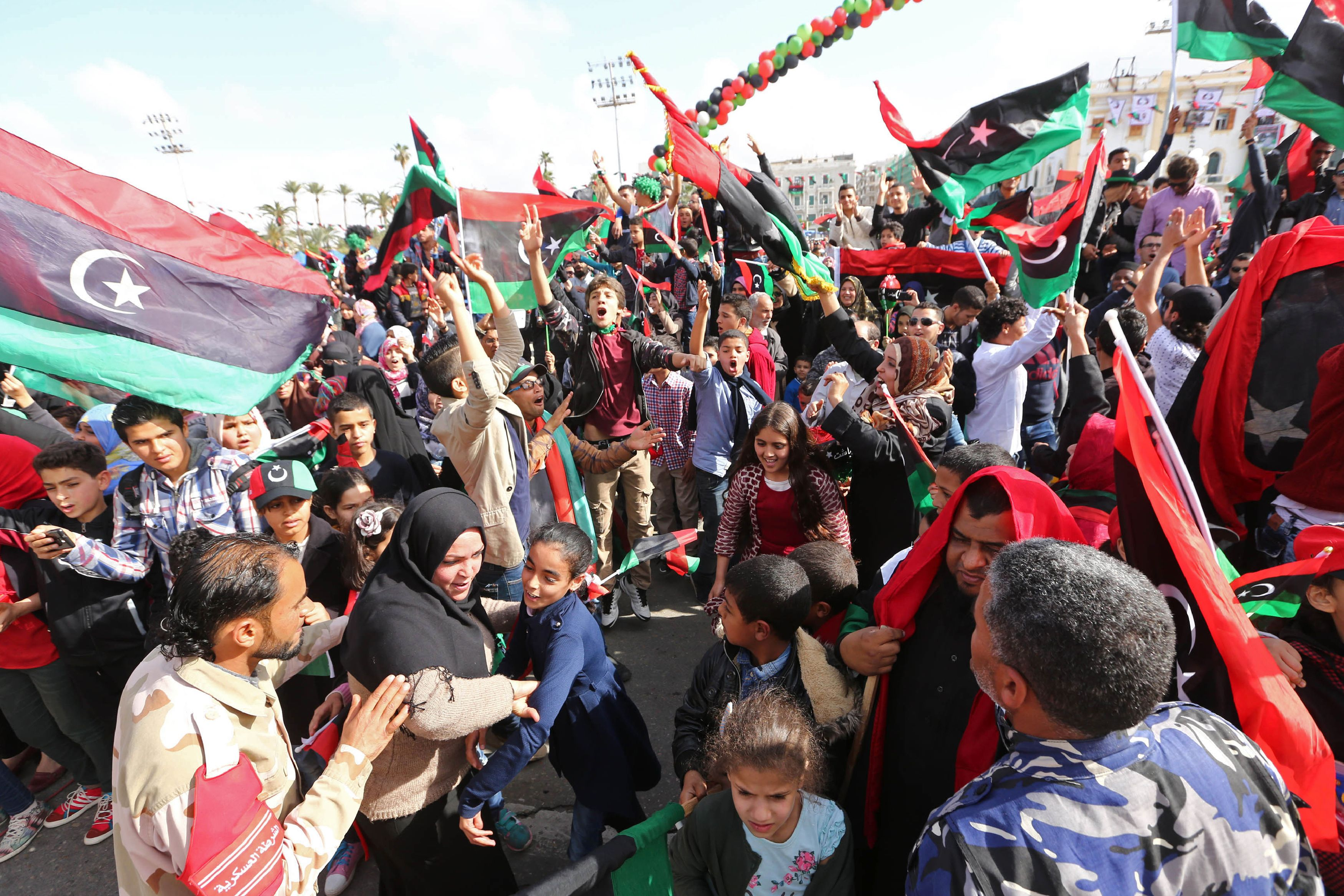 Libyans take part in celebrations markin...Libyans take part in celebrations marking the fifth anniversary of the Libyan revolution, which toppled strongman Moamer Kadhafi, at Martyrs' Square in the capital Tripoli, on February 17, 2016. / AFP / MAHMUD TURKIAMAHMUD TURKIA/AFP/Getty Images