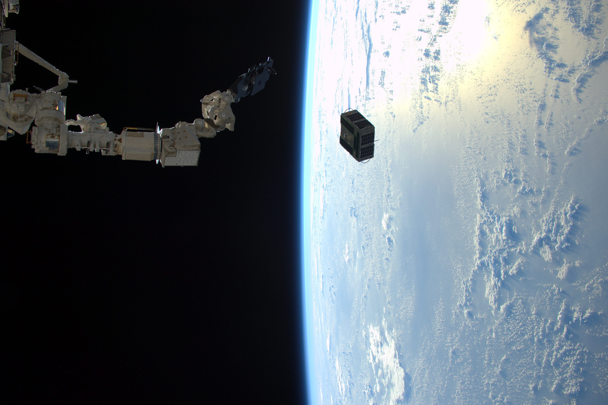 NASA successfully deploys two combined satellites from Texas universities...epa05140040 A handout image dated 29 January 2016 and made available by ESA/NASA on 02 February 2016, showing an image made by Expedition 46 flight engineer Tim Peake of ESA aboard the International Space Station, as the robotic arm in Japan's Kibo laboratory successfully deployed two combined satellites from Texas universities. The pair of satellites -- AggieSat4 built by Texas A&M University students, and BEVO-2 built by University of Texas students -- together form the Low Earth Orbiting Navigation Experiment for Spacecraft Testing Autonomous Rendezvous and Docking (LONESTAR) investigation.  EPA/TIM PEAKE / ESA / NASA /
