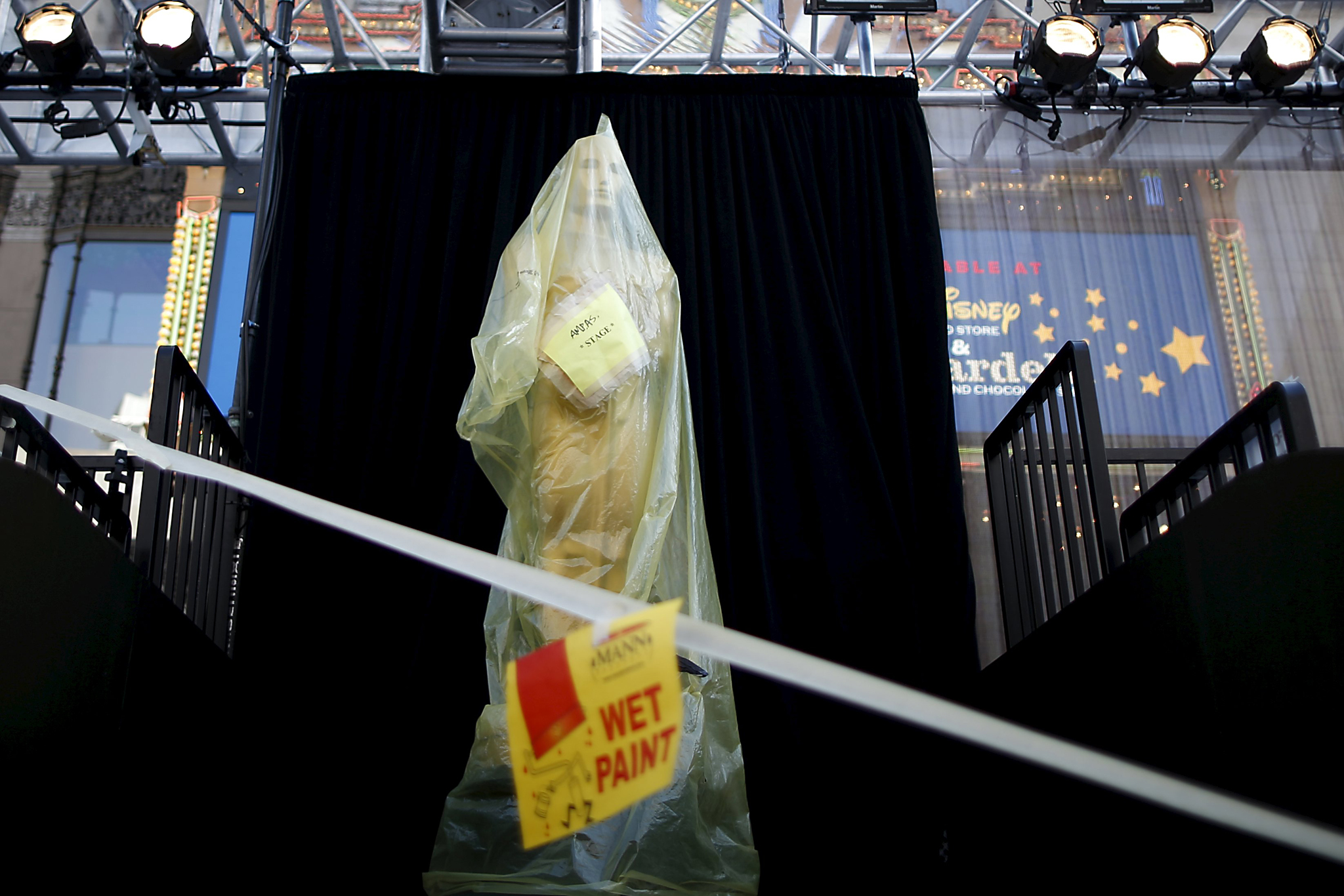 An Oscar statue stands covered in plastic at the entrance to the Dolby Theatre as preparations continue for the 88th Academy Awards in Hollywood...An Oscar statue stands covered in plastic at the entrance to the Dolby Theatre as preparations continue for the 88th Academy Awards in Hollywood, Los Angeles, California February 25, 2016. The Oscars will be presented February 28, 2016. REUTERS/Lucy Nicholson      TPX IMAGES OF THE DAY