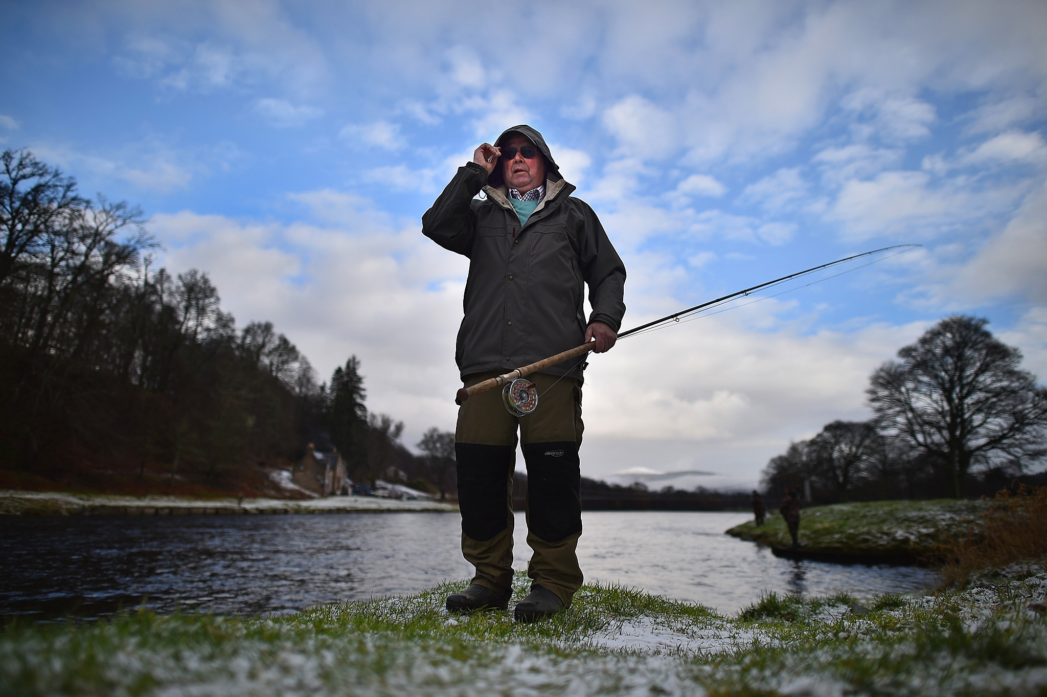 An angler holds his fishing pole during the opening day of the salmon season on the River Spey on February 11, 2016 in Aberlour, Scotland. The annual opening day ceremony took place at Penny Bridge, with the traditional pouring of a bottle of Aberlour twelve year old single malt Scotch whisky into the river.  (Photo by Jeff J Mitchell/Getty Images)