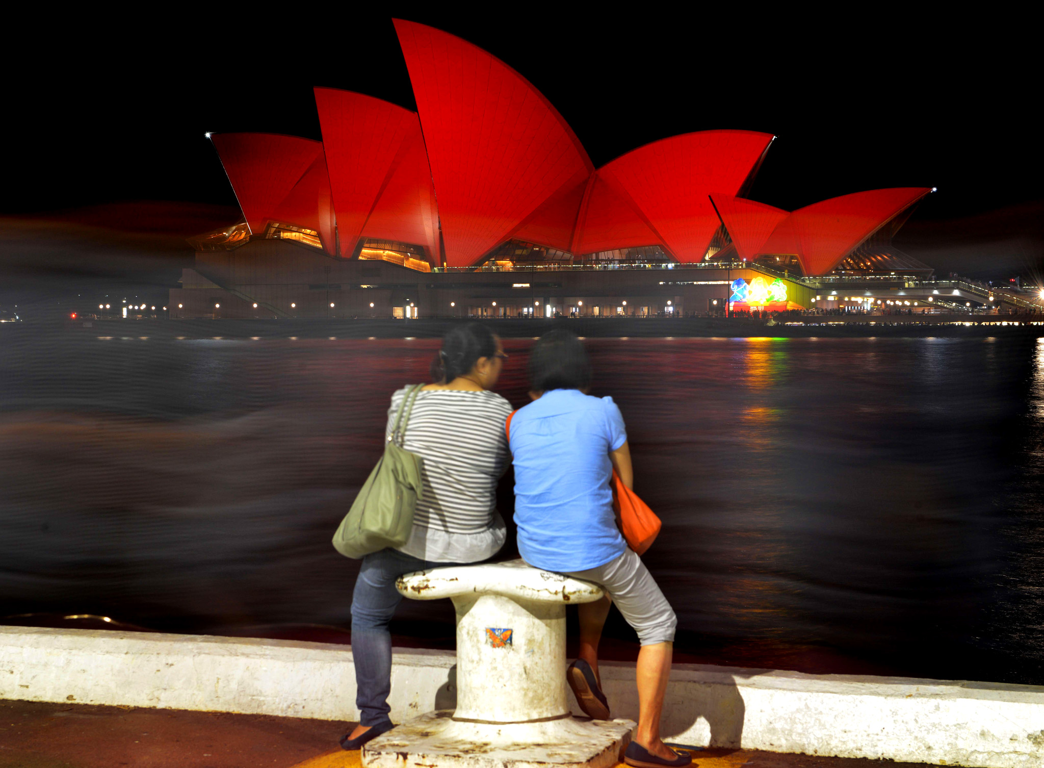 This long exposure photograph shows Chin...This long exposure photograph shows Chinese tourists sitting and viewing the Sydney Opera House which is lit up red to welcome in the Lunar New Year in Sydney on February 8, 2016. The Lunar New Year of the Monkey begins on February 8. AFP PHOTO / Peter PARKSPETER PARKS/AFP/Getty Images