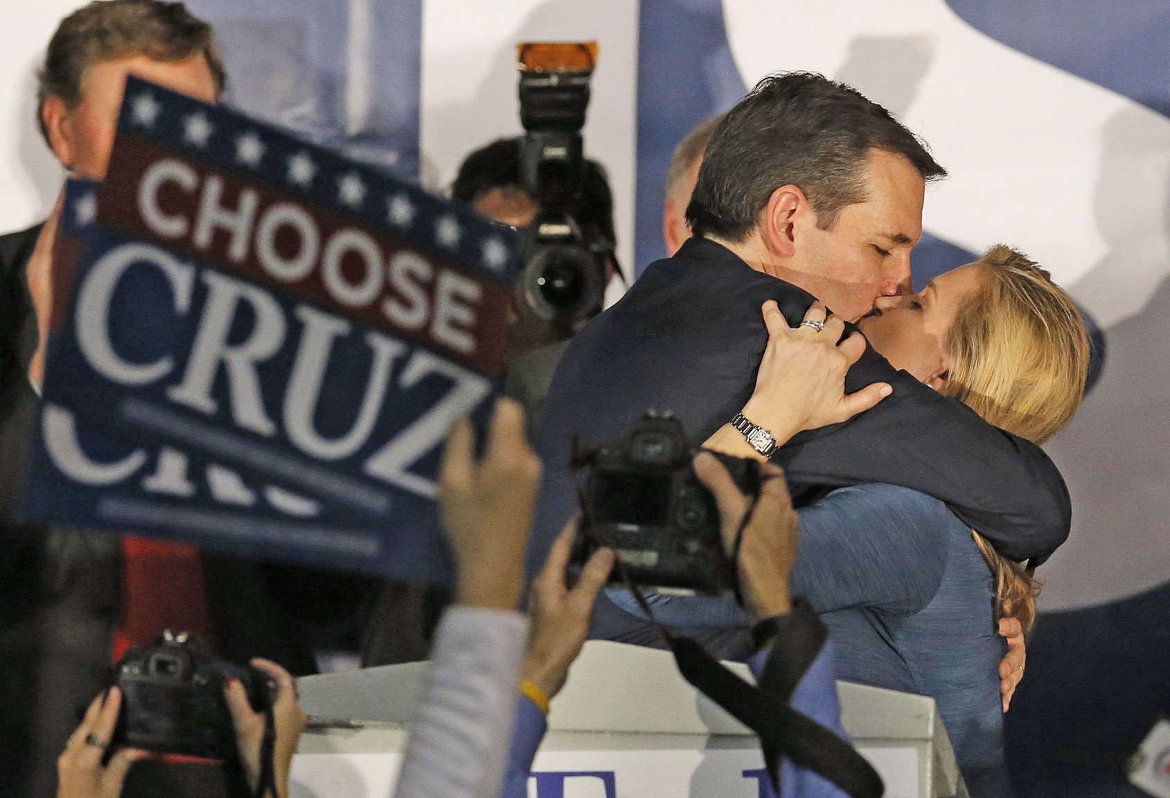 U.S. Republican presidential candidate Ted Cruz kisses his wife Heidi Cruz after winning at his Iowa caucus night rally in Des Moines