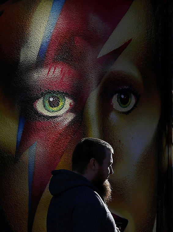 A shaft of light falls on to a mural of David Bowie in Sheffield, Britain