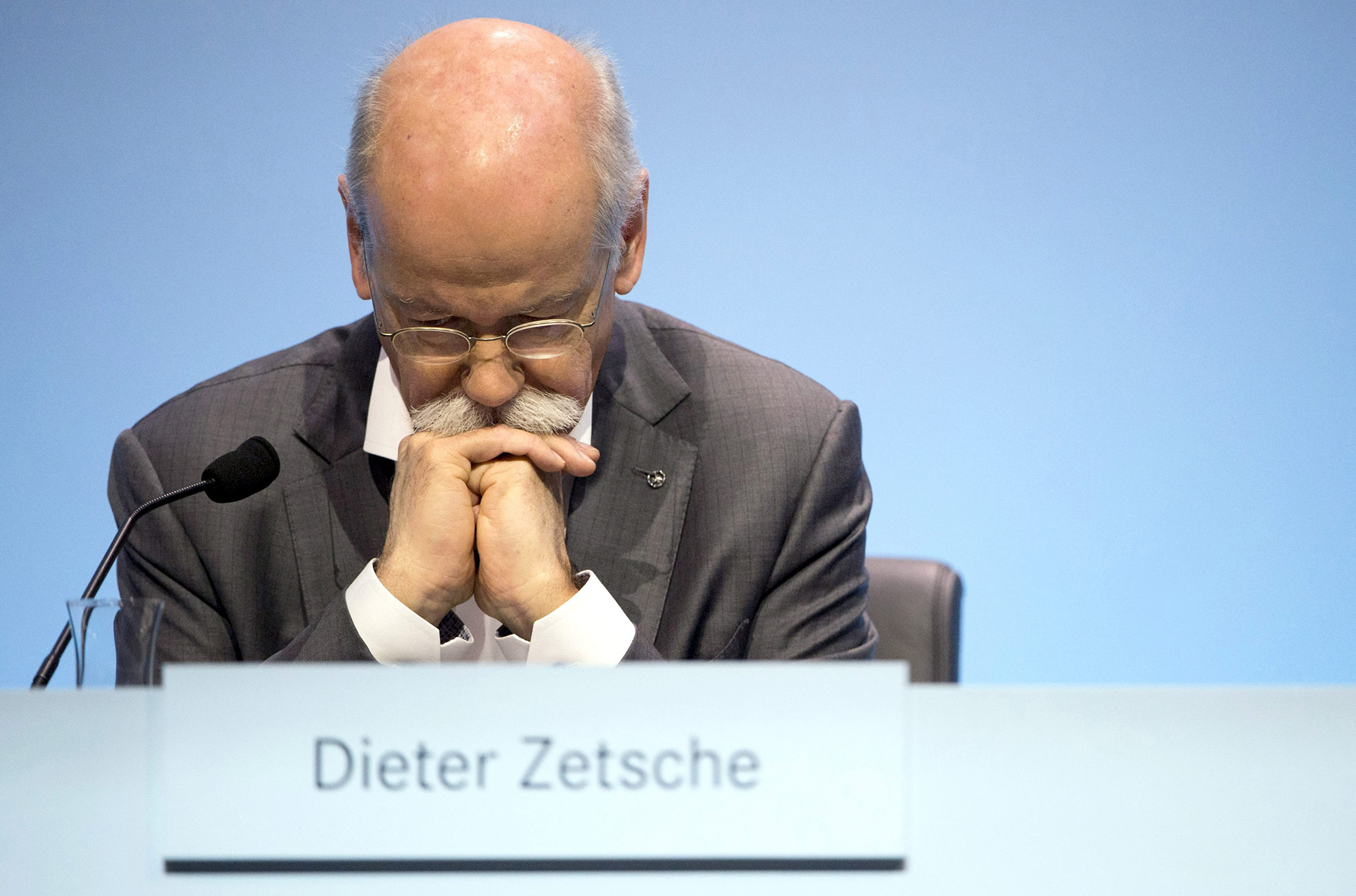 Daimler AGÂ CEO Dieter Zetsche reacts as he attends the annual press conference of German automotive corporation Daimler in Stuttgart, Germany