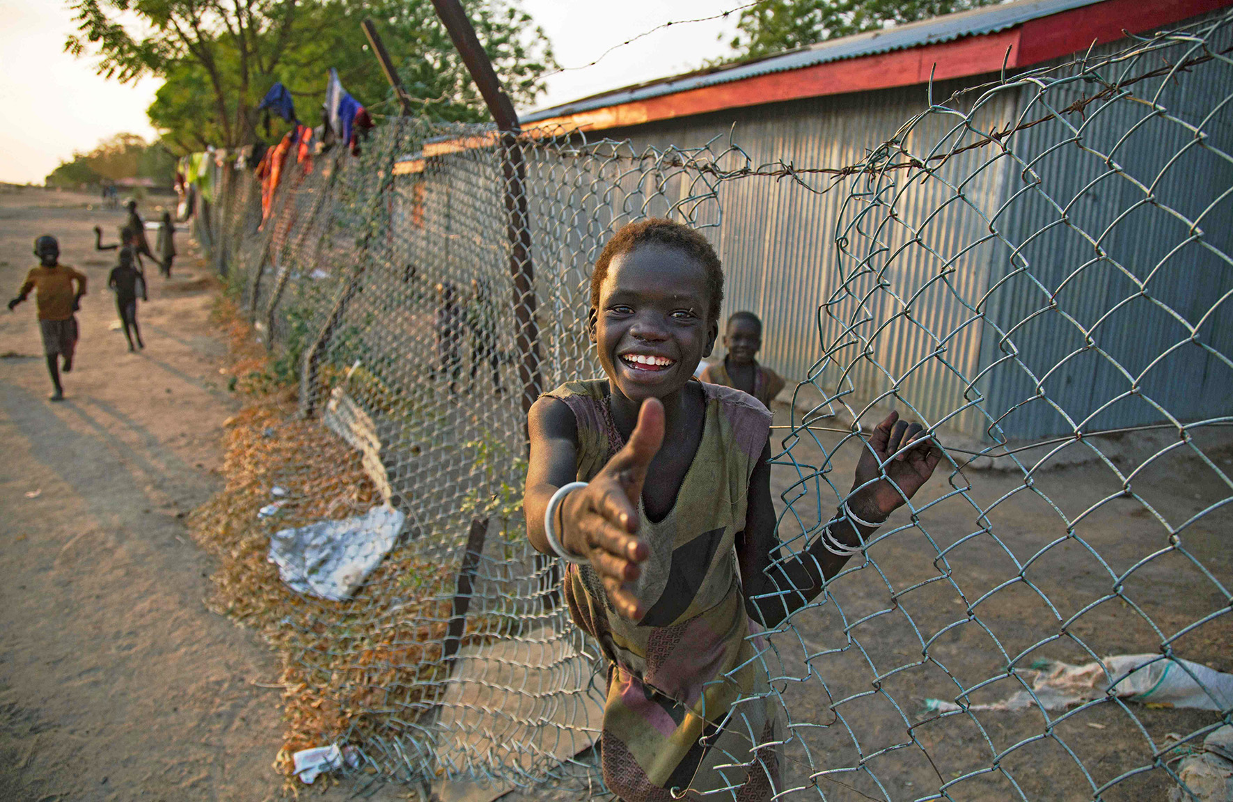 A child climbs through a fench inside the former compound of the International Committee of the Red Cross (ICRC) in the half-emptied village of Leer, South Sudan, on February 3, 2016.   A large part of the civilian population fled the village due to the fighting between Army forces and the Sudan People's Liberation Movement in Opposition (SPLM-IO) on October 2, 2015. Government forces pushed the rebels out but the clashes were followed with intensive looting by armed men who entered humanitarian compounds and stole equipment, medical supplies and money. / AFP / ALBERT GONZALEZ FARRANALBERT GONZALEZ FARRAN/AFP/Getty Images