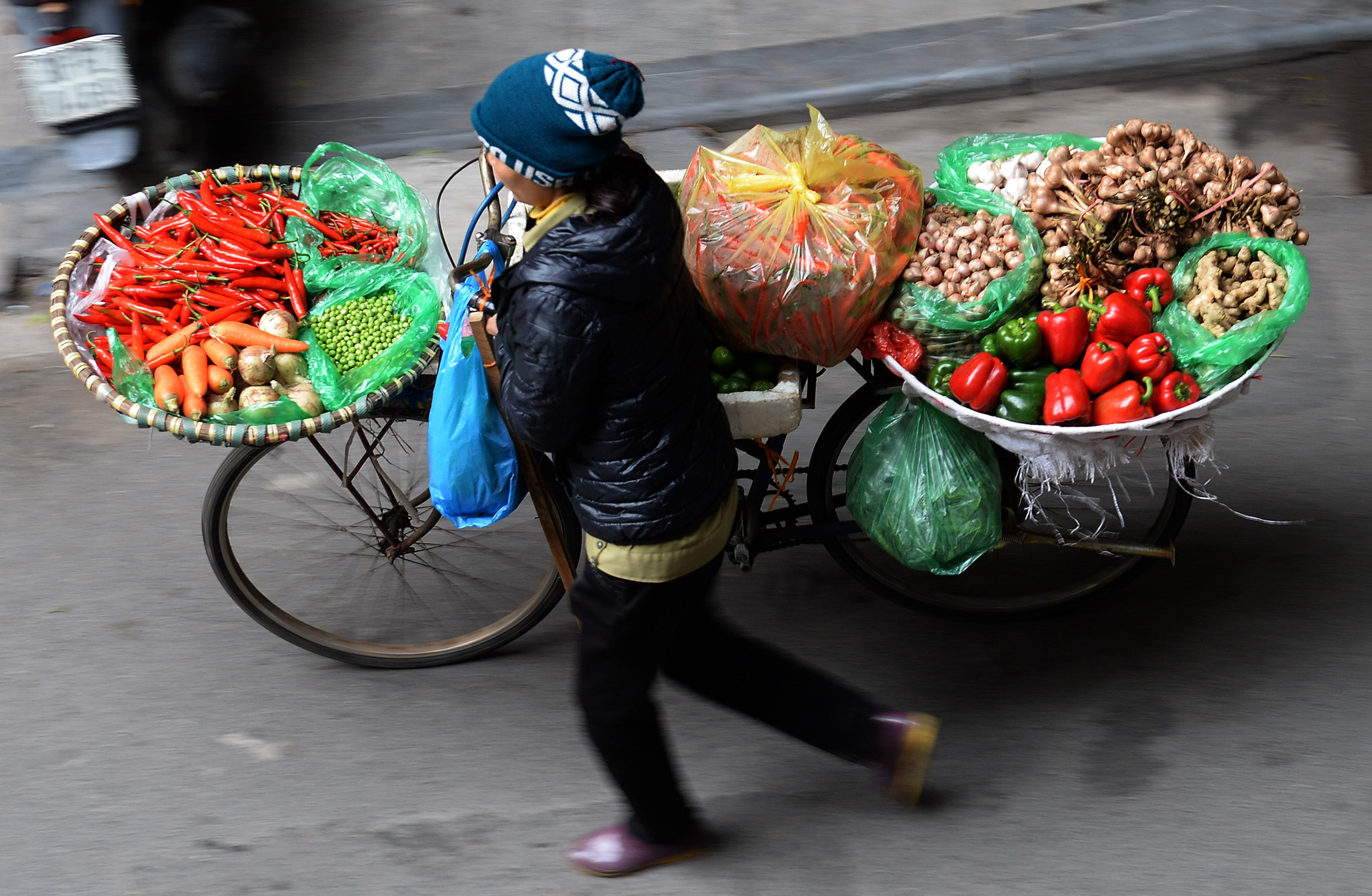 A vendor sells vegetables along a street in downtown Hanoi, as Vietnamese prepare to celebrate the Lunar New Year