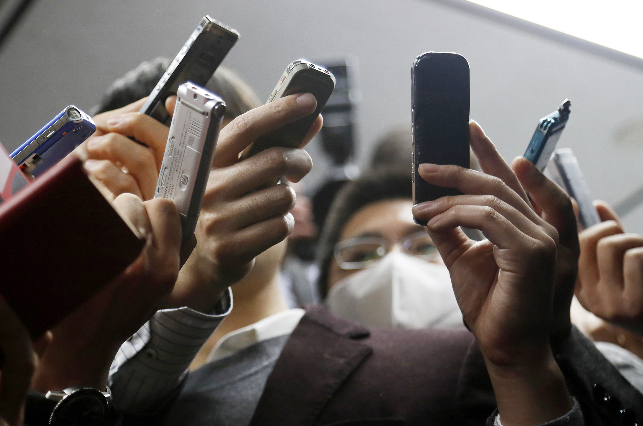 Sharp Corp. President Kozo Takahashi Attends Third-Quarter Earnings News Conference...Reporters hold recorders as Kozo Takahashi, president of Sharp Corp., not pictured, leaves a news conference in Tokyo, Japan, on Thursday, Feb. 4, 2016. Sharp reported its fifth straight loss as the embattled maker of Aquos flat-screen televisions decides between two competing bailout offer