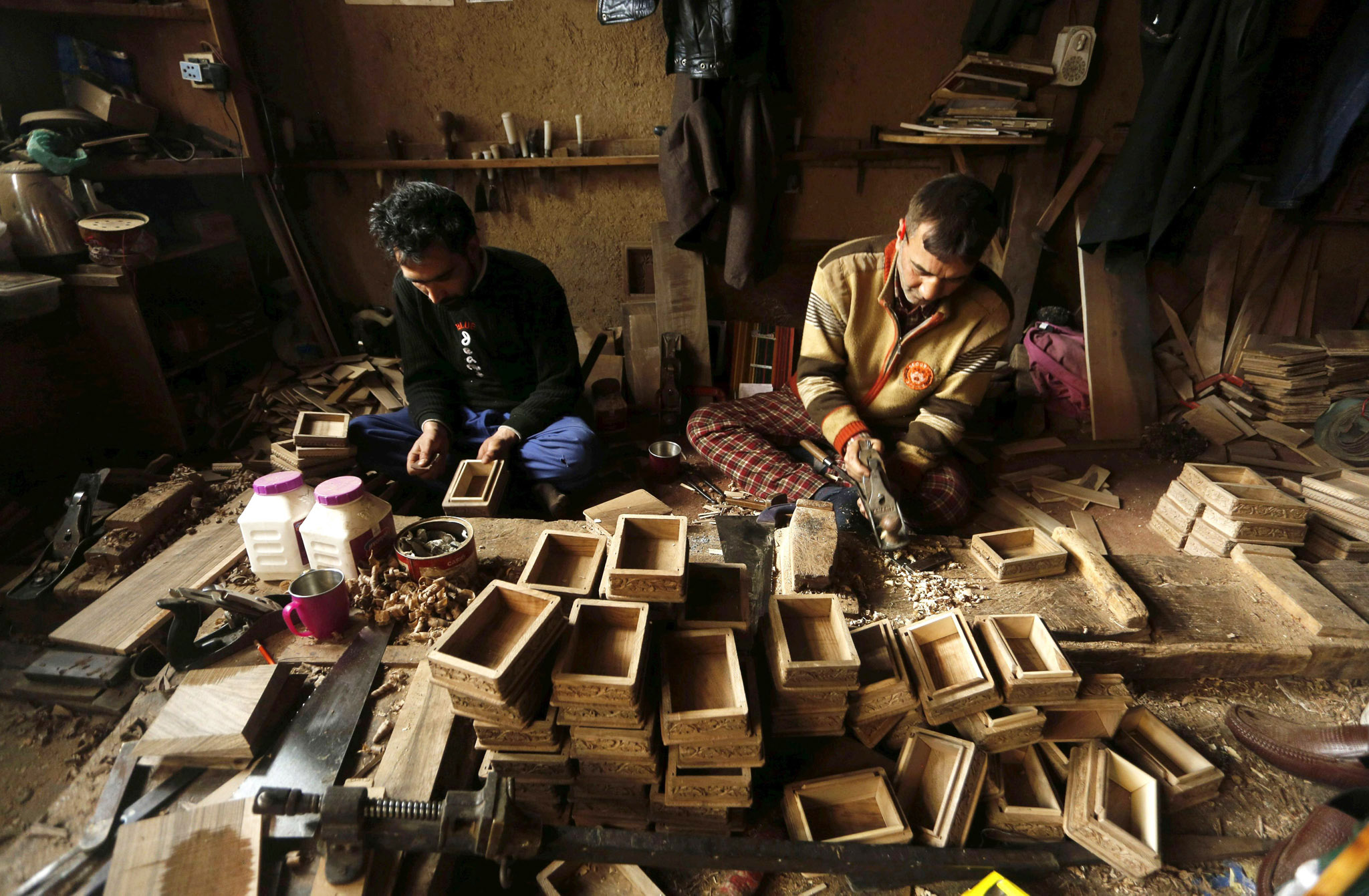 Wood business in Kashmir...epa05141371 Kashmiri woodwork craftsmen work at their workshop in Srinagar, summer capital of Indian Kashmir, 03 February 2016. People associated with walnut woodwork complain of economic hardships  because of low wages, which has resulted in decline in their business.  EPA/FAROOQ KHAN