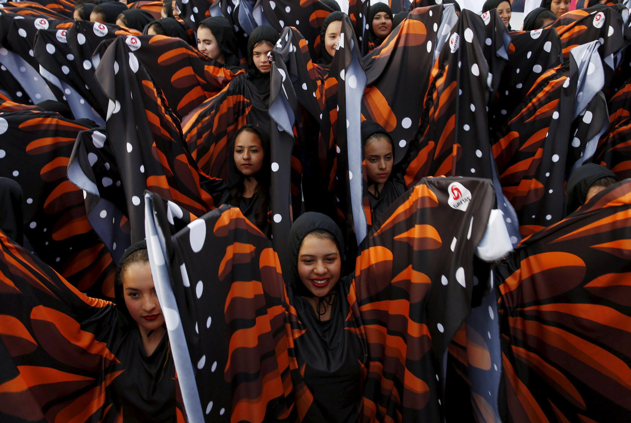Girls dressed as butterflies perform during a meeting of Pope Francis (not pictured) and youths at the Jose Maria Morelos y Pavon stadium in Morelia, Mexic