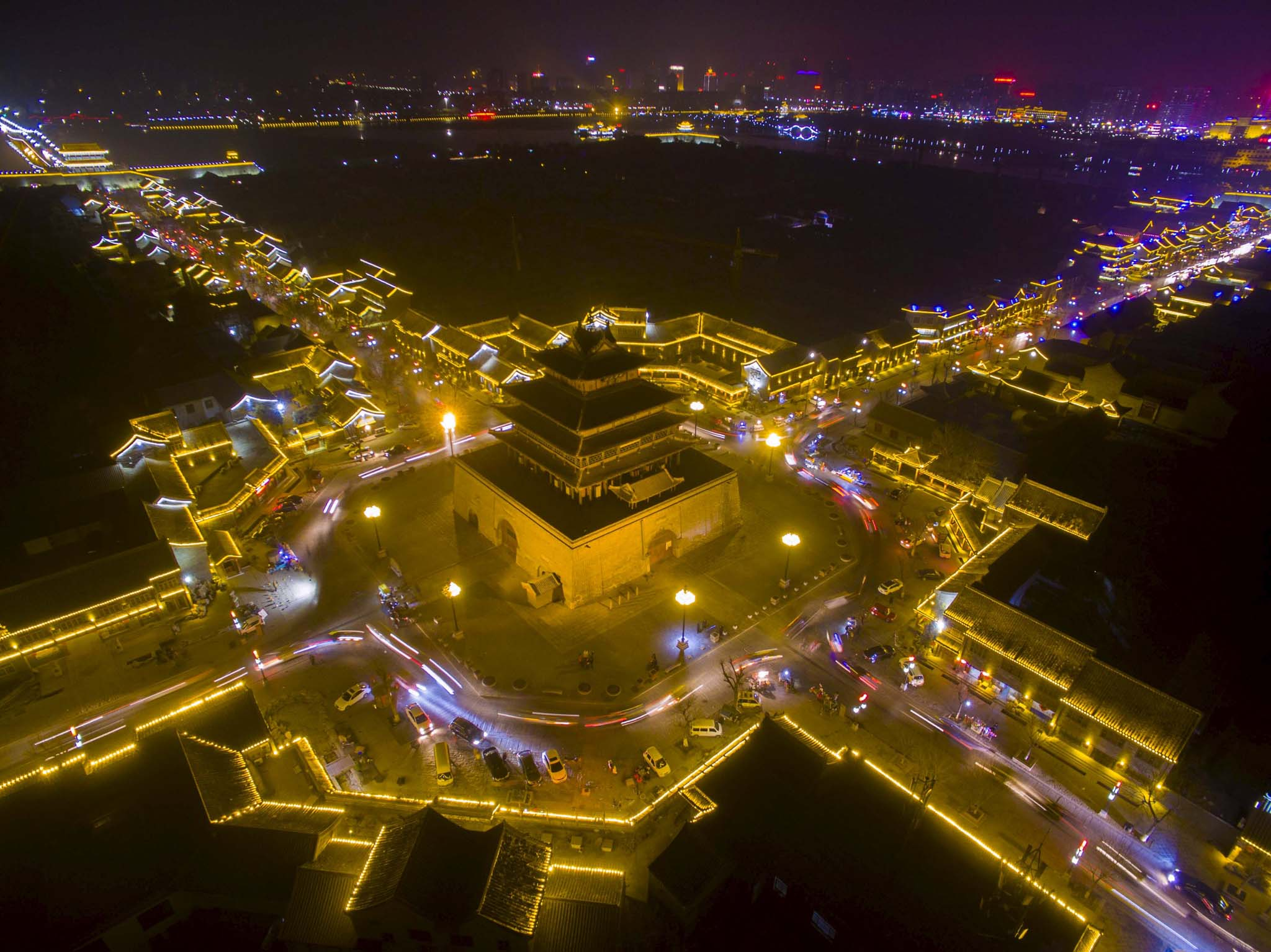 Traditional buildings of a tourist spot are seen lit up at night in Liaocheng, Shandong province