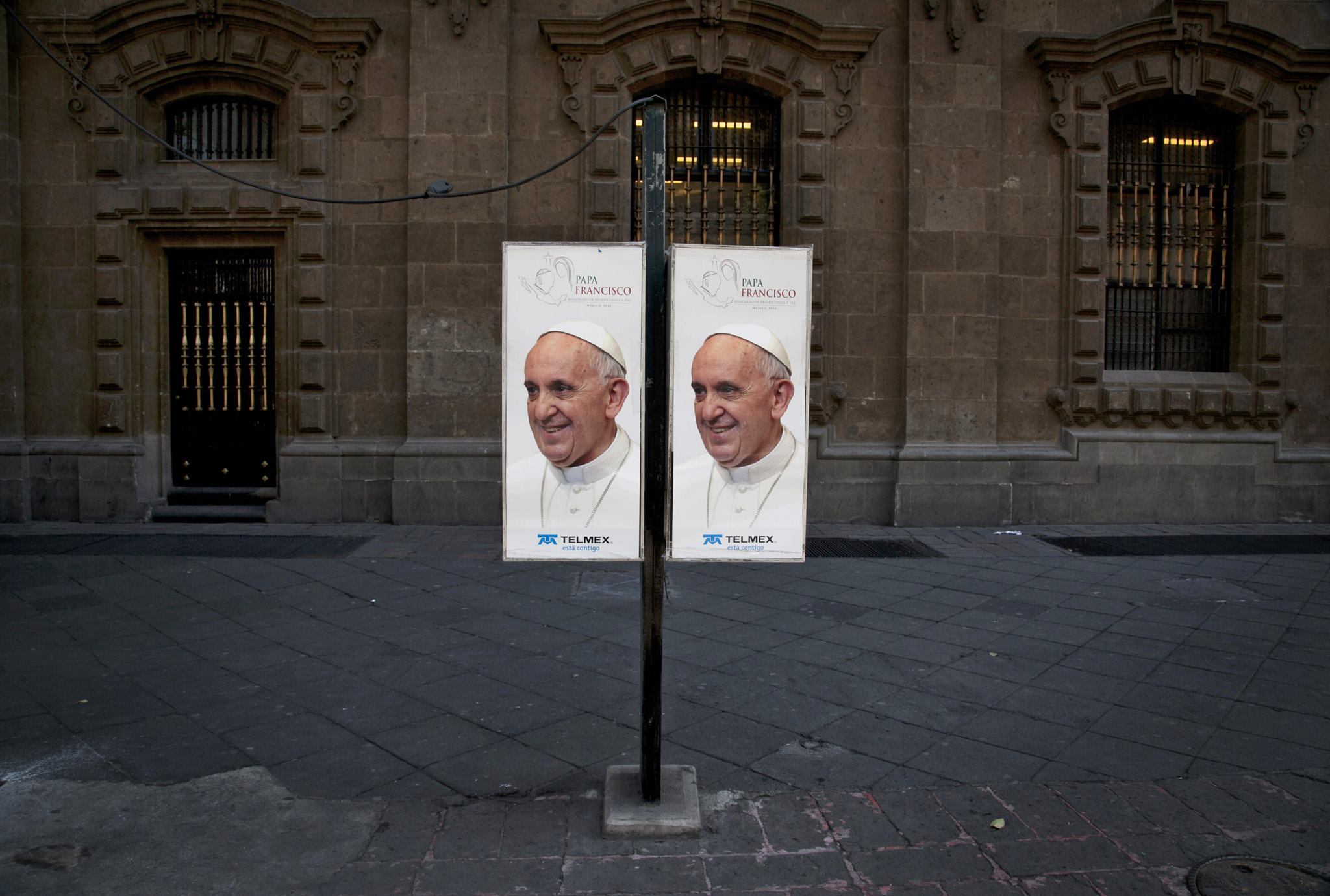 Public phone booths are covered with images of Pope Francis in downtown Mexico City