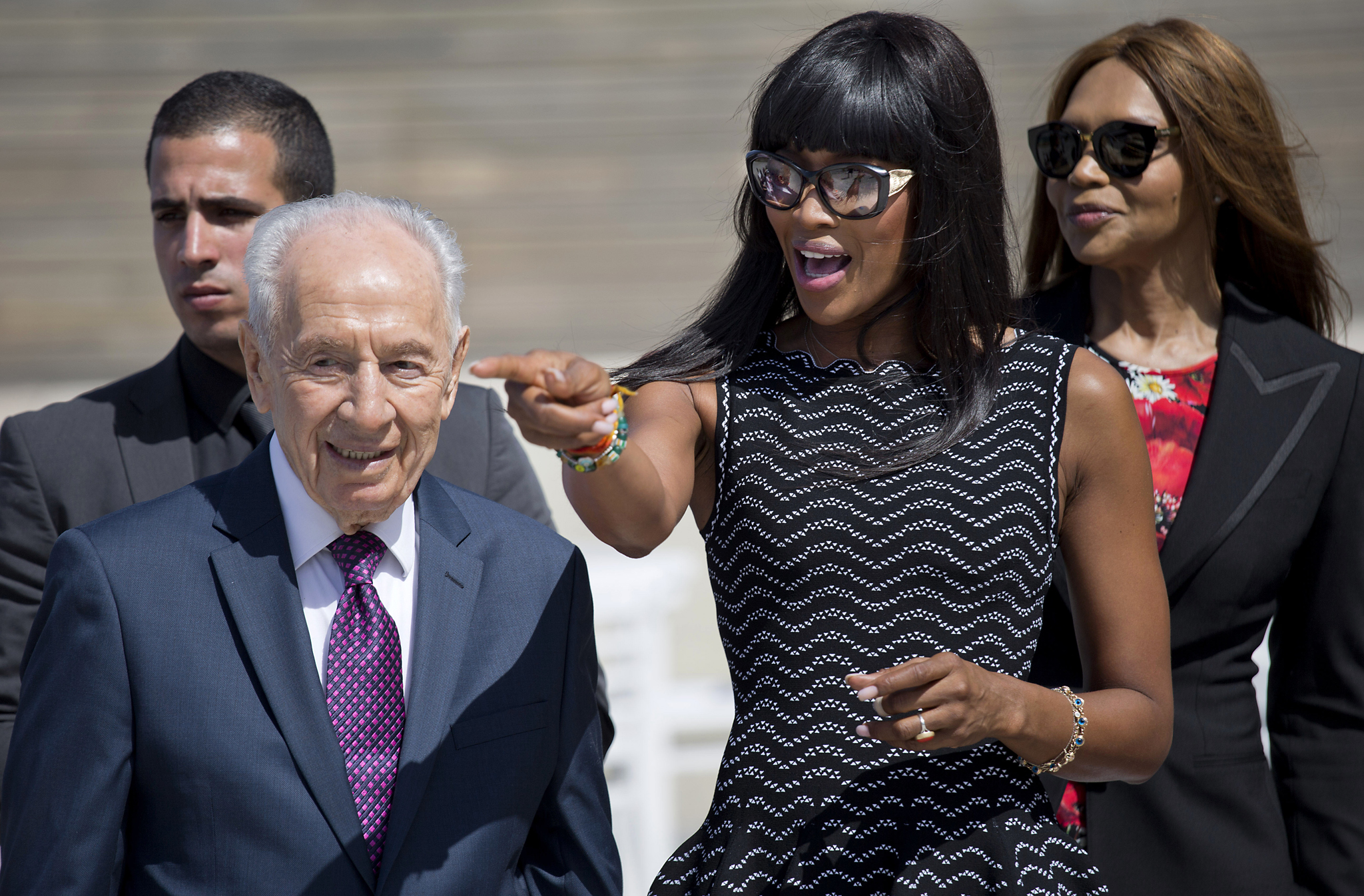 Shimon Peres , Naomi Campbell...Naomi Campbell, second right, meets with former Israeli President Shimon Peres during an event for International Women's Day in Tel Aviv, Israel, Tuesday, March 8, 2016. (AP Photo/Ariel Schalit)