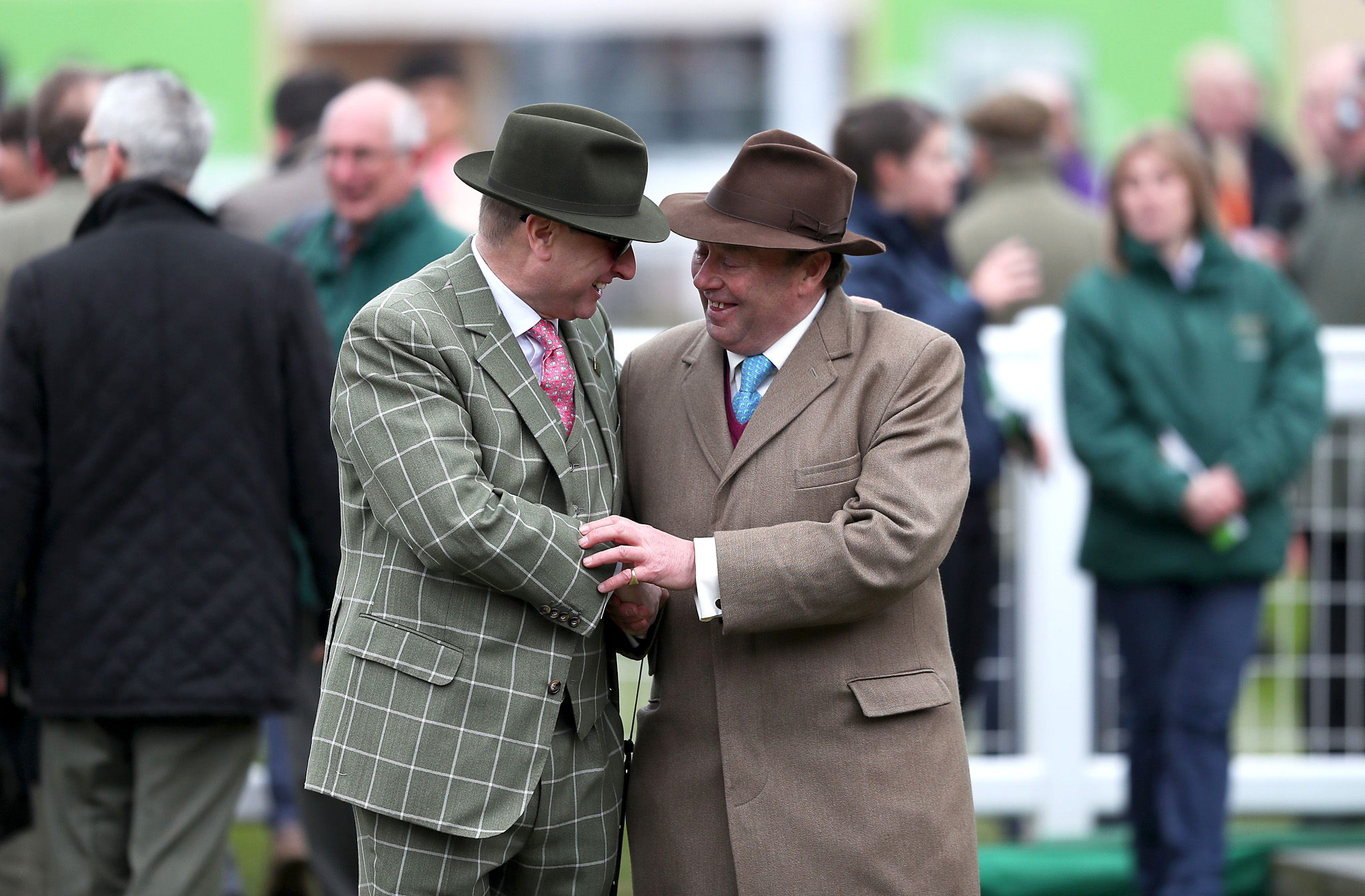 2016 Cheltenham Festival - Champion Day - Cheltenham Racecourse...Rich Ricci congratulates winning trainer Nicky Henderson (right) after Altior wins the Sky Bet Supreme Novices' Hurdle during Champion Day of the 2016 Cheltenham Festival at Cheltenham Racecourse. PRESS ASSOCIATION Photo. Picture date: Tuesday March 15, 2016. See PA story RACING Cheltenham. Photo credit should read: David Davies/PA Wire. RESTRICTIONS: Editorial Use only, commercial use is subject to prior permission from The Jockey Club/Cheltenham Racecourse. Call +44 (0)1158 447447 for further information.