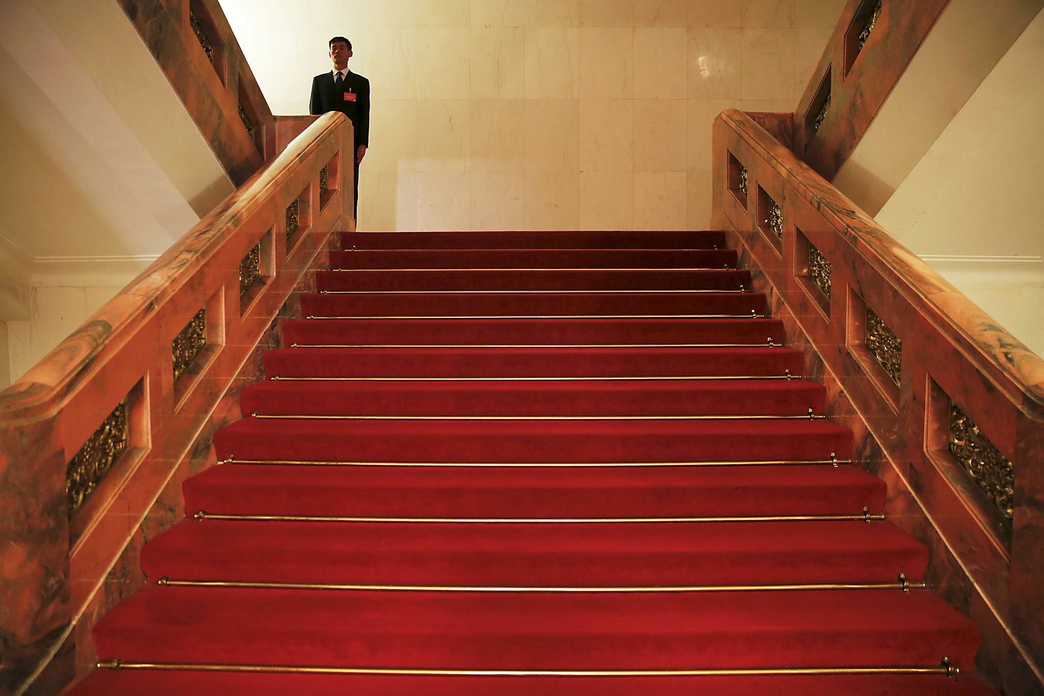 A security agent stands in between floors of the Great Hall of the People in Beijing...A security agent stands in between floors of the Great Hall of the People ahead of annual sessions of the National People's Congress (NPC) and Chinese People's Political Consultative Conference (CPPCC), in Beijing March 2, 2016.   REUTERS/Damir Sagolj