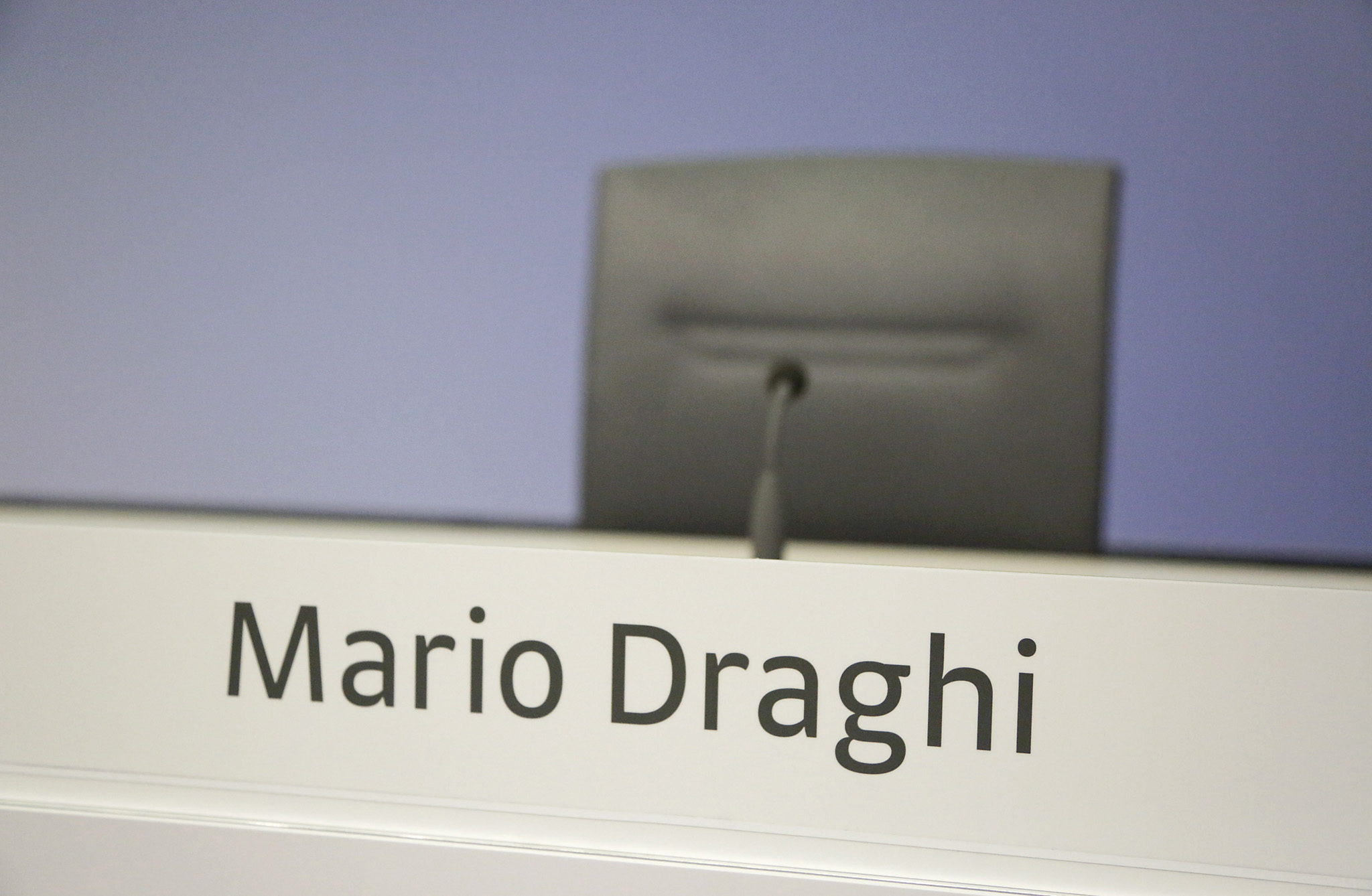 European Central Bank President Mario Draghi Announces Interest Rate Decision...An empty chair stands in the news conference room before the arrival of Mario Draghi, president of the European Central Bank (ECB), to announce the bank's interest rate decision at the ECB headquarters in Frankfurt, Germany, on Thursday, March 10, 2016. Draghi will unveil fresh economic projections that for the first time will extend to 2018, and oil's slump will likely lead to downward revisions from the December outlook when inflation was projected to average 1 percent this year and 1.6 percent in 2017