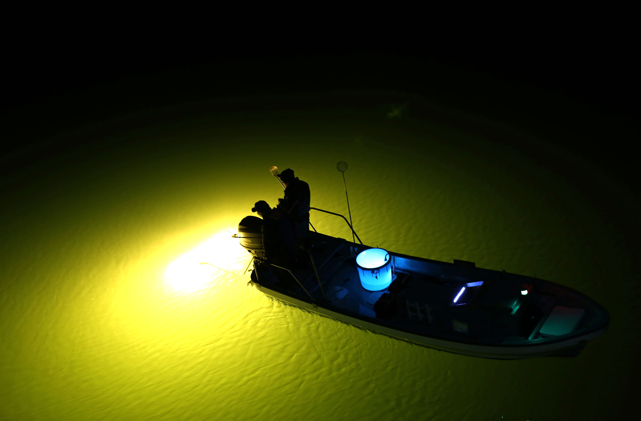 Young Eels Night Fishing...A fishermen uses lamps to search for young eels on the Yoshino River in Tokushima, Japan, on Saturday, March 12, 2016. Young eels are approximately 2 inches (5 centimeters) in length. Those caught during fishing season are sold at a price of between 100 yen and 300 yen to farming facilities. Photographer: Buddhika Weerasinghe/Bloomberg.