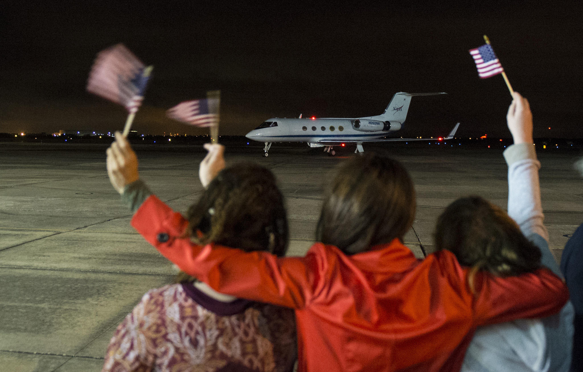 The plane carrying Expedition 46 Commander Scott Kelly of NASA is seen as it taxis after landing at Ellington Field after his return to Earth