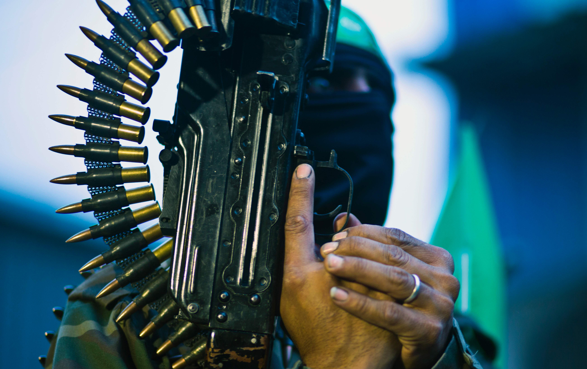 A member of the Ezzedine al-Qassam Briga...A member of the Ezzedine al-Qassam Brigades, the military wing of the Palestinian Islamist movement Hamas holds his weapon during a rally to mark the 12th anniversary of the death of assassinated Hamas spiritual leader Sheikh Ahmed Yassine on March 23, 2016 outside his home in Gaza city.  / AFP PHOTO / MAHMUD HAMSMAHMUD HAMS/AFP/Getty Images