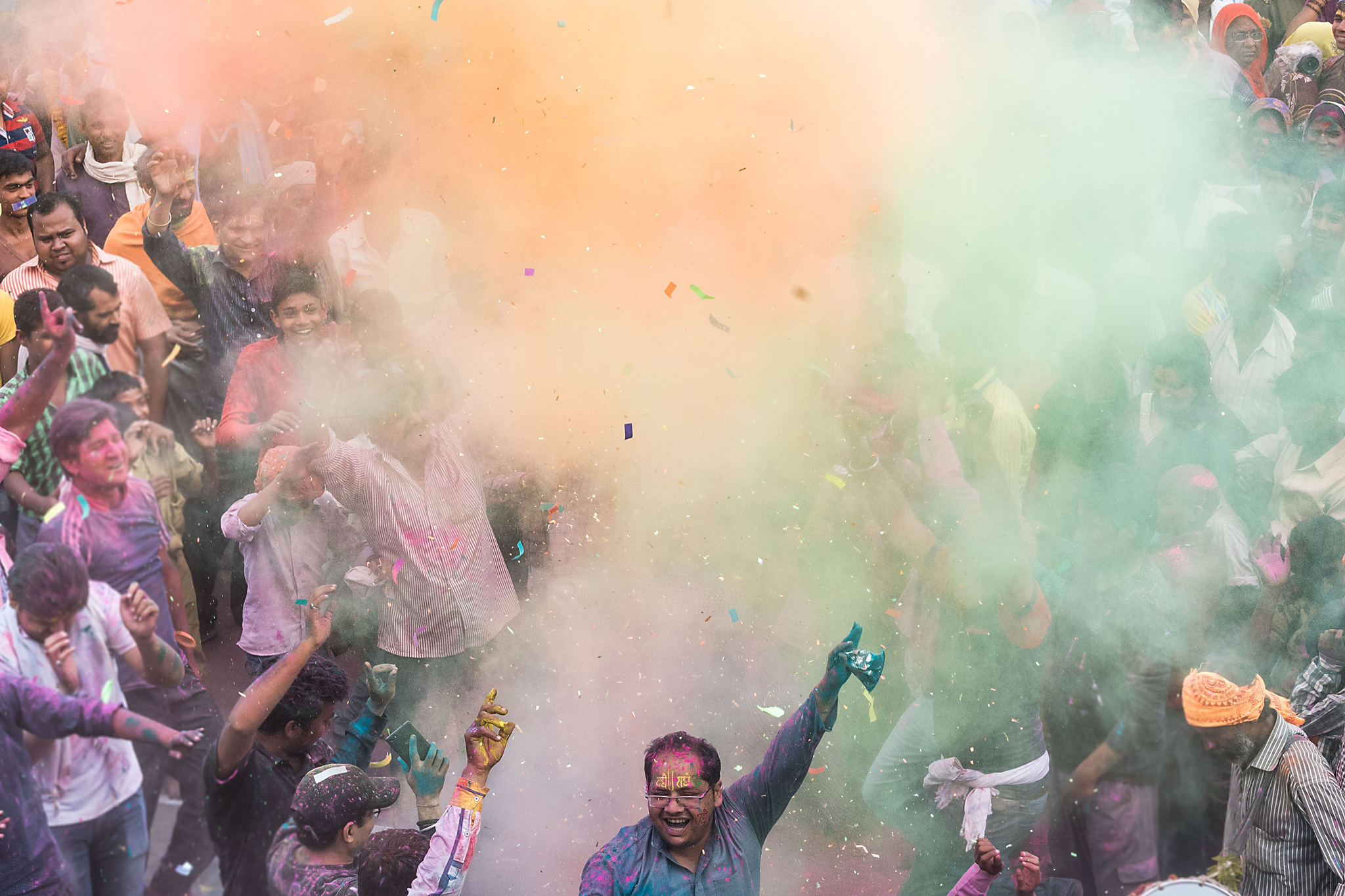 Indian villagers are covered in coloured...Indian villagers are covered in coloured powders during the Lathmar Holi festival at the Radha Rani temple in Barsana, some 130kms from New Delhi on March 16, 2016.  During the Lathmar Holi festival, the women of Barsana, the legendary hometown of Radha, consort of Hindu God Krishna, attack the men from Nandgaon, the hometown of Hindu God Krishna, with wooden sticks in response to their efforts to put color on them. / AFP PHOTO / FranÁois Xavier MARITFRANCOIS XAVIER MARIT/AFP/Getty Images